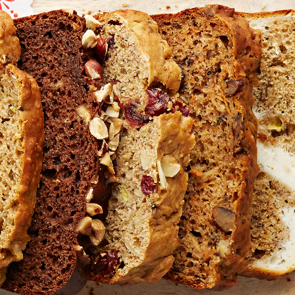 This flavorful banana bread combines almonds, cranberries, orange juice, and honey for a make-ahead snack or breakfast.