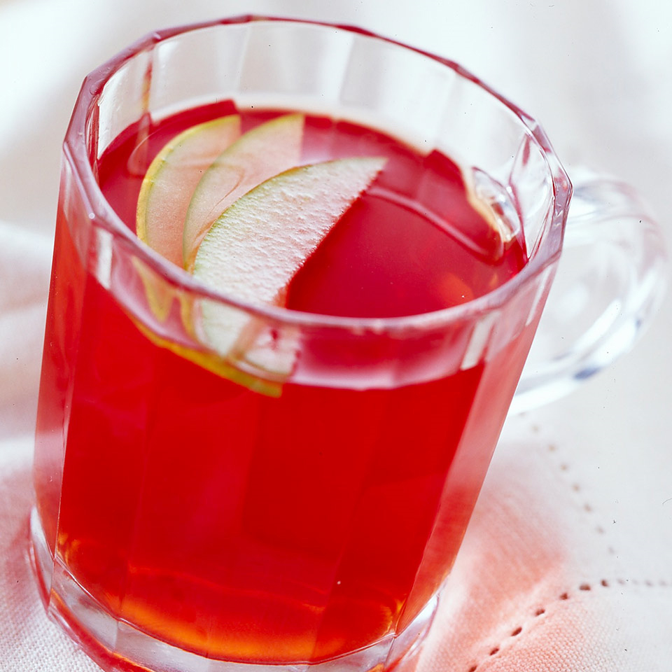 Throw cinnamon, cloves, apple cider, and cranberry-raspberry juice into a slow cooker to make this easy and tasty berry-apple cider.