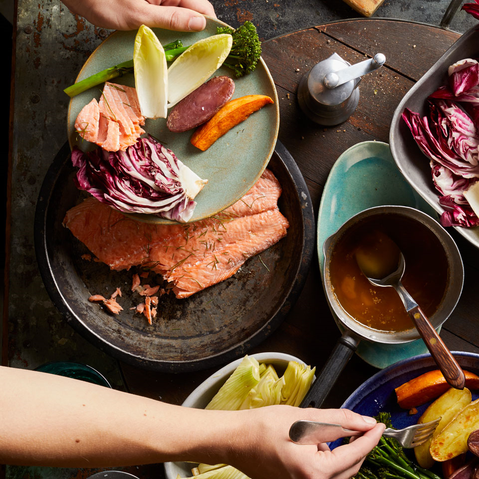 In this family-style meal, a platter full of salmon and roasted and raw vegetables--served with a Northern Italian-inspired garlic-anchovy dip--lets everyone choose their own dining adventure. Serve with crusty bread and white wine.