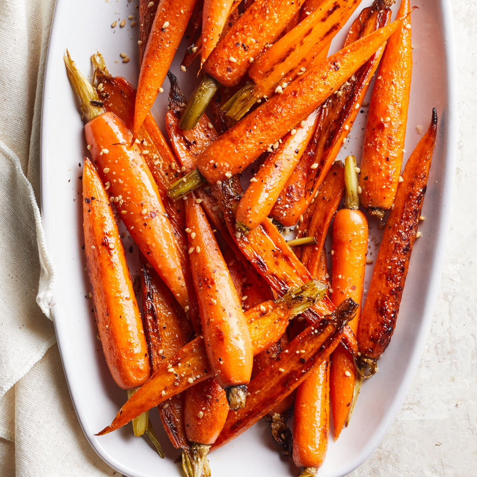 In this quick vegetable side dish, maple-vinegar-glazed carrots are topped with gomasio, a blend of toasted sesame seeds and salt. Find gomasio in the natural-foods section or Asian-foods section at large supermarkets or at Asian markets. Or substitute 2 tablespoons toasted sesame seeds and 1/4 teaspoon salt.