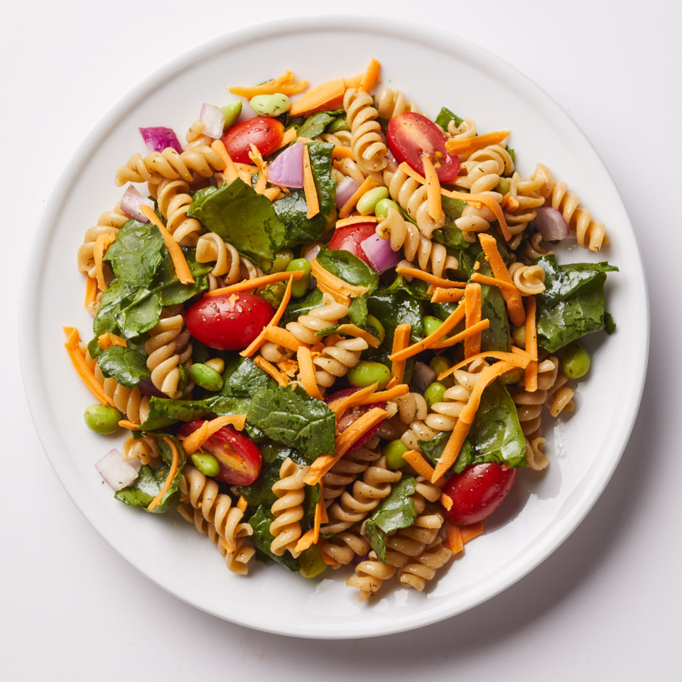 Edamame gives this veggie-packed vegan pasta salad a bit of feel-full protein. Serve topped with extra freshly ground pepper, if desired.