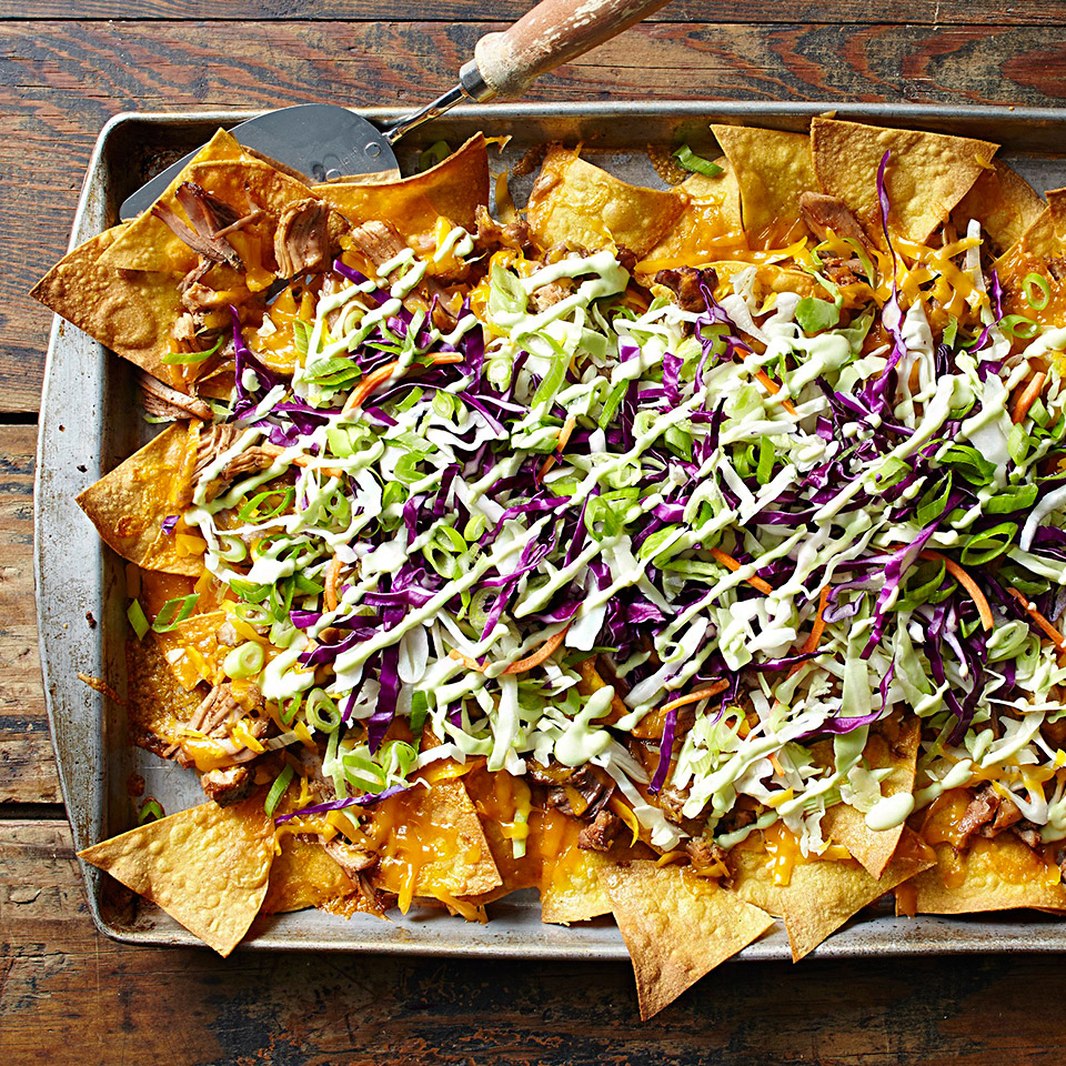 Make your own healthier nachos-with-a-twist from toasted corn tortilla wedges. Asian-inspired flavors infuse the pork and the light crema that's made with Greek yogurt.