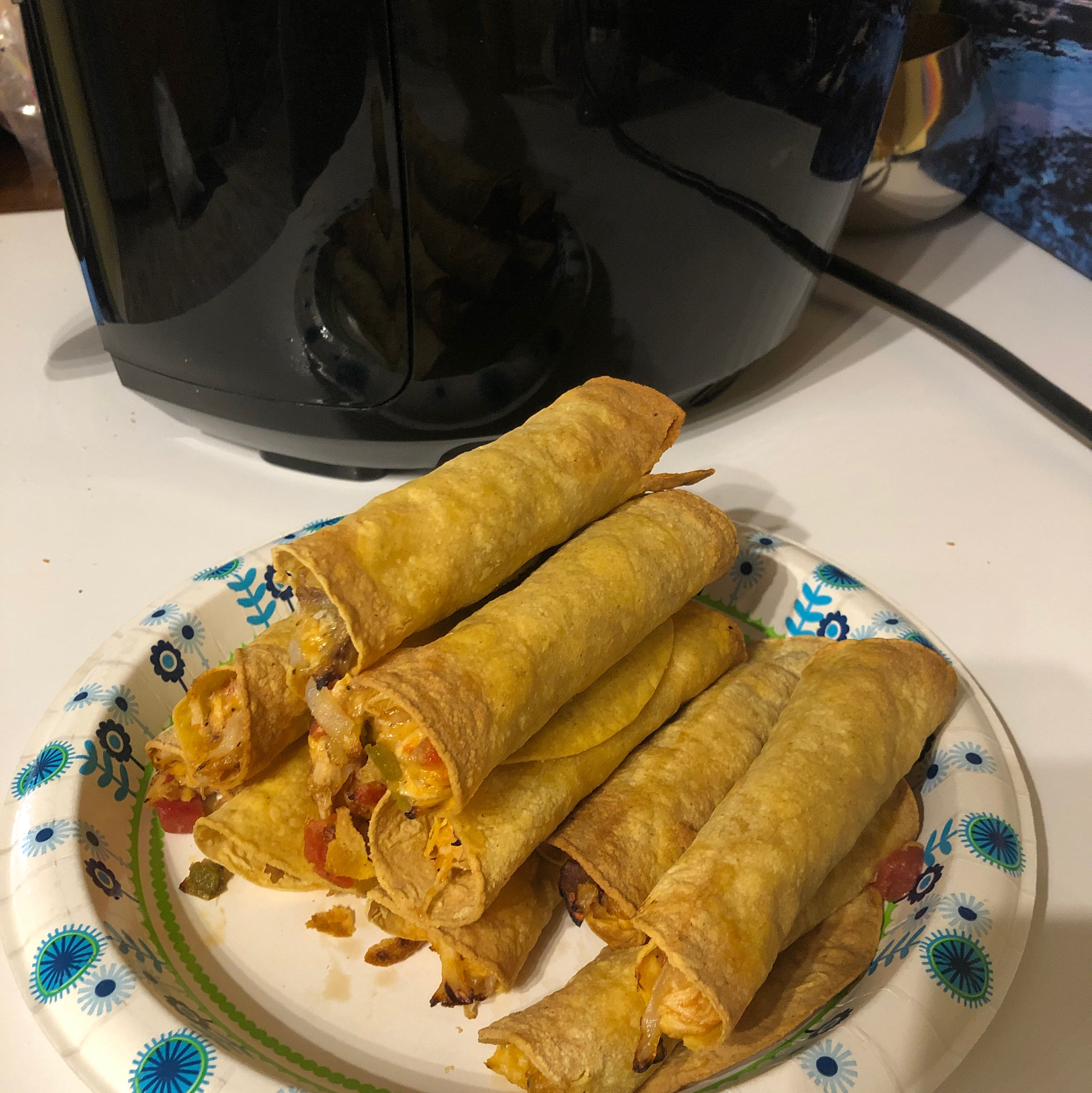 "Shredded rotisserie chicken will makes quick work of the prep, but you can always use home-cooked chicken. ""These taquitos are healthier than deep fried ones,"" says Yoly. ""Serve with sides of sour cream, Mexican tomato sauce, and guacamole, or your choice of sides."""