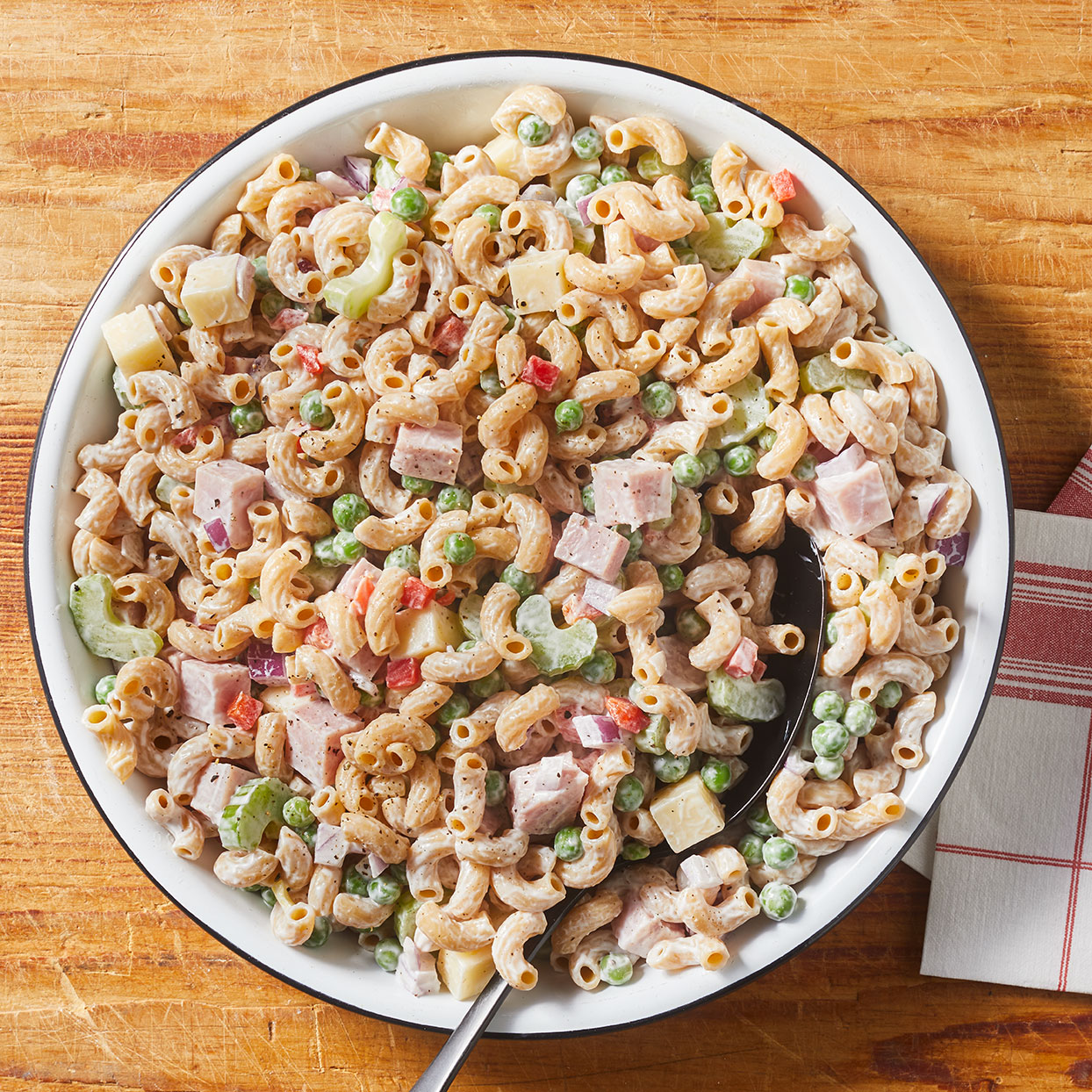 Bring this quintessential Southern macaroni salad, made with whole-wheat macaroni, celery, peas and ham, to your next picnic or barbecue. It's the perfect salad to feed a crowd! Source: EatingWell.com, April 2020