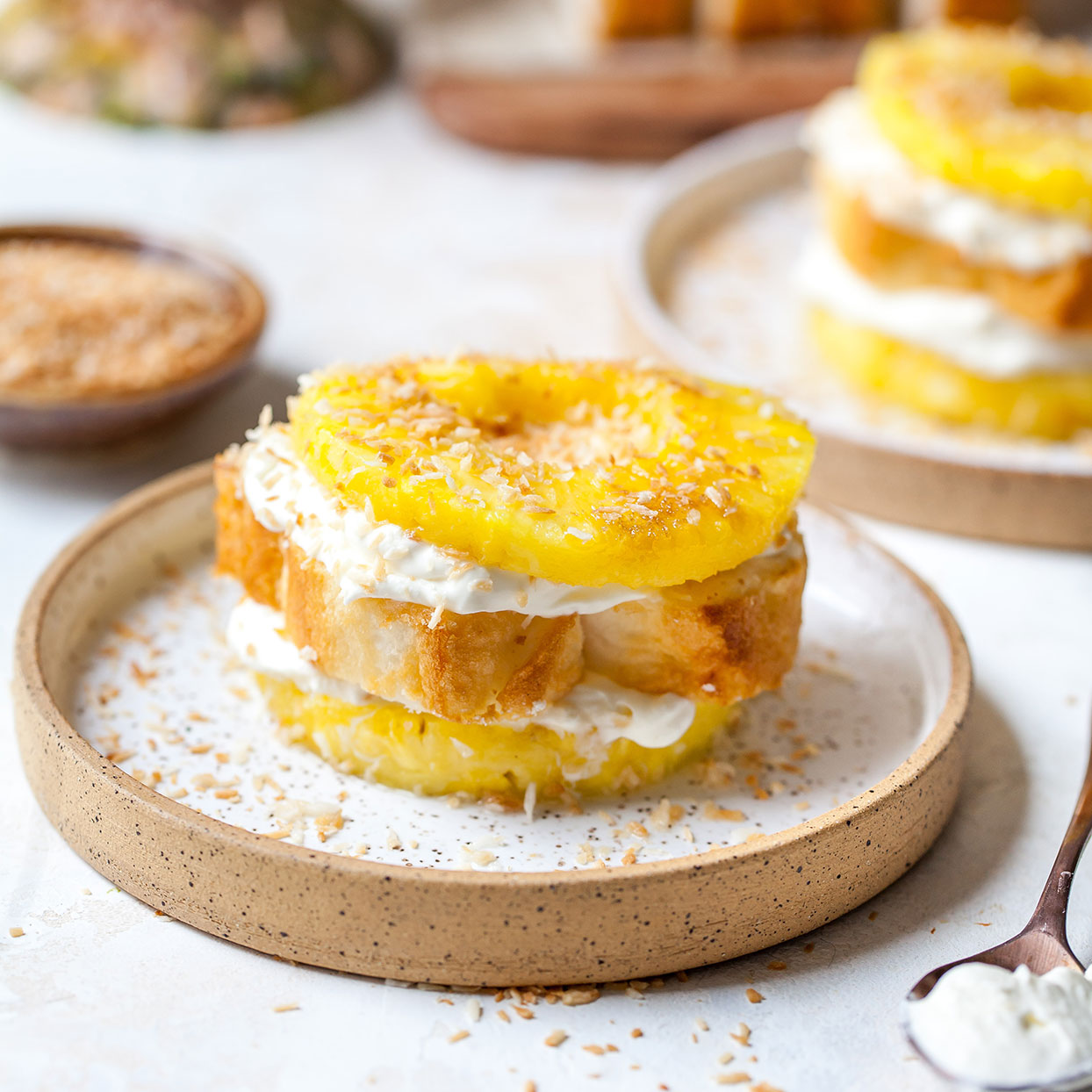 Prepare this beautiful stacked cream and pineapple napoleons recipe when you want a special dessert without a lot of effort. We use store-bought angel food cake to keep this pineapple dessert brilliantly simple and fast.