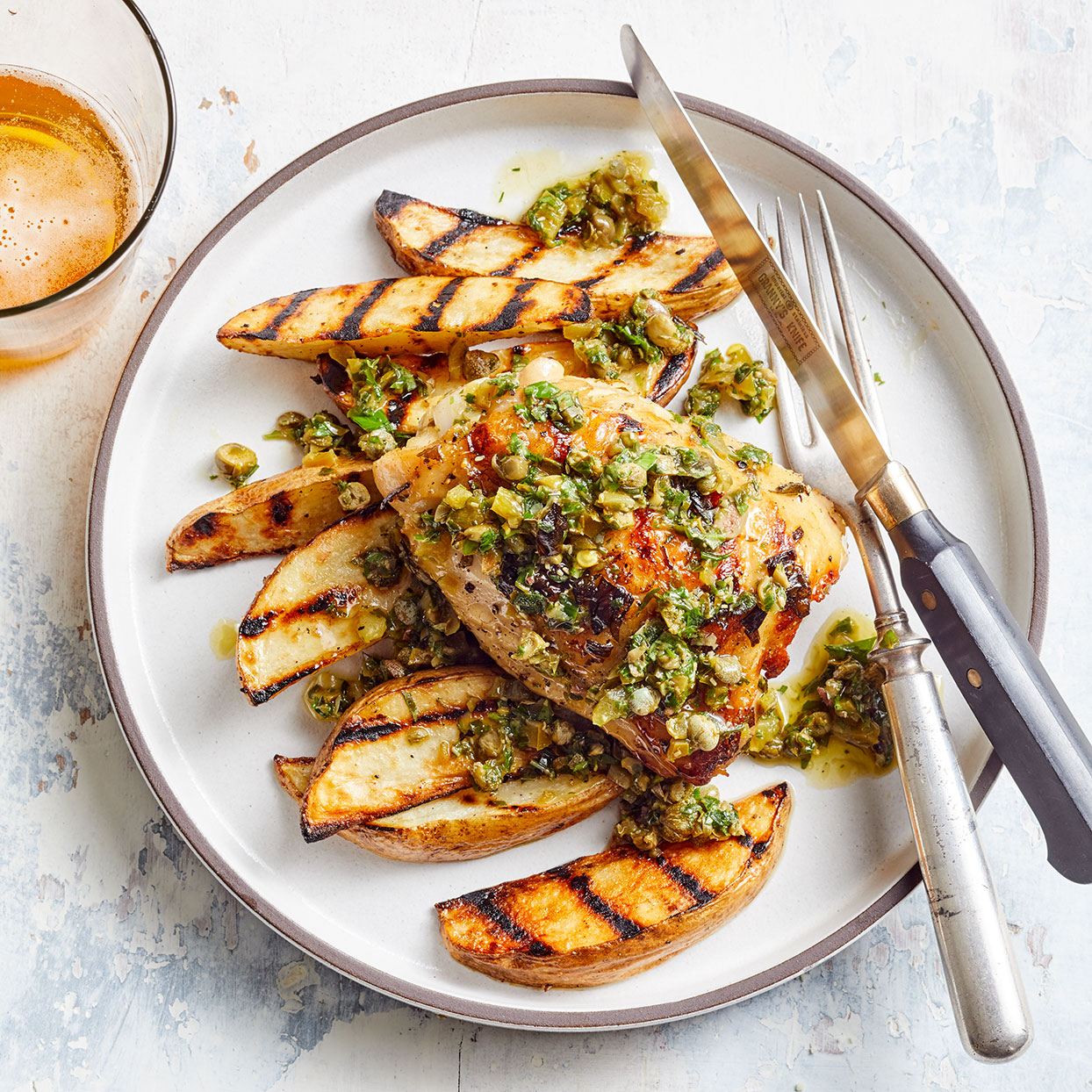 We combine fresh herbs, capers, lemon juice and olive oil along with the juices collected from the chicken as it rests to make a simple sauce that livens up this take on poulet frites, or chicken and fries. Source: EatingWell Magazine, May 2020
