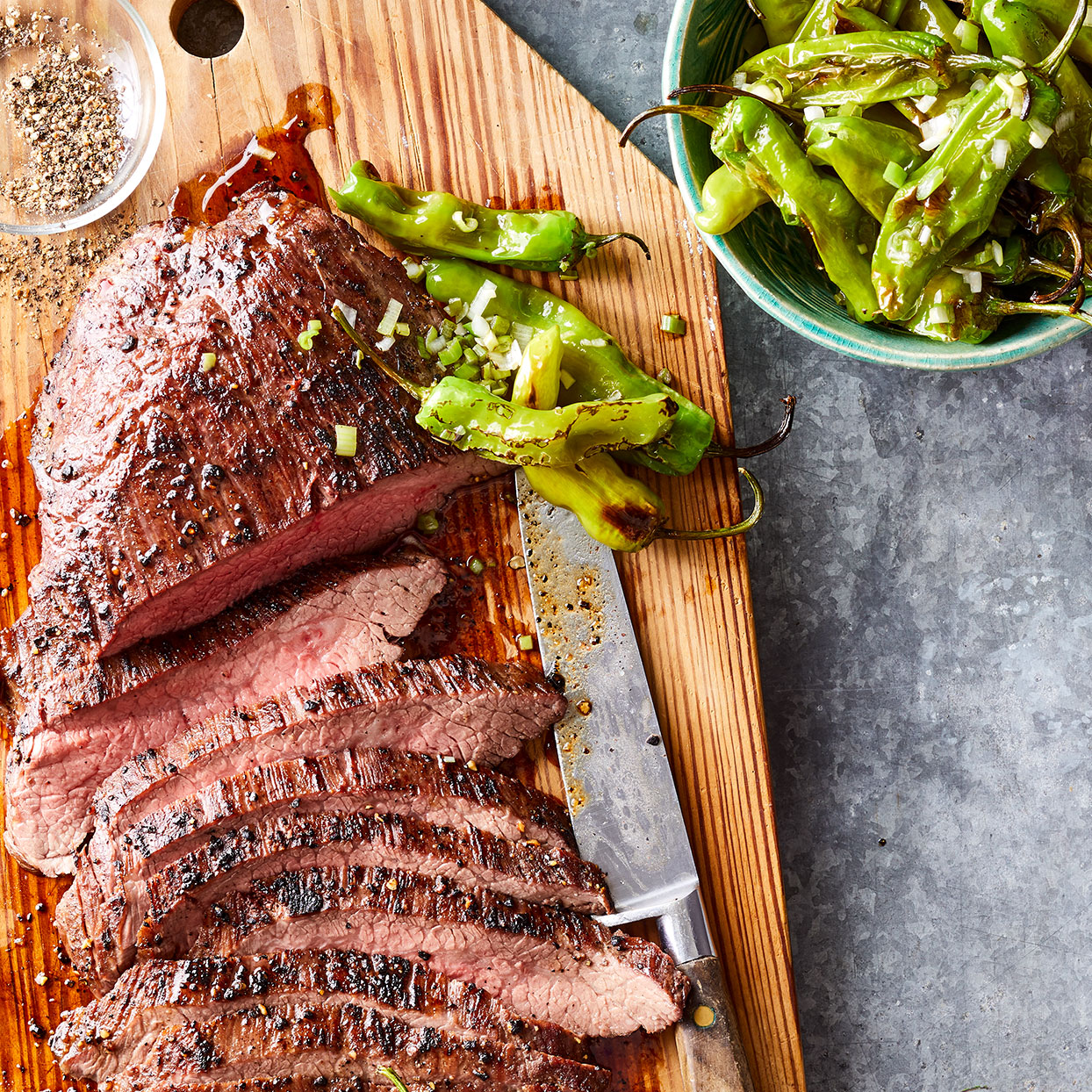 This flank steak recipe comes together easily on a baking sheet, but if you're itching to take it outside, fire up the grill instead. Just be sure to use a grill basket for the peppers so you don't end up chasing them around the grates, or worse, losing them to the fire.