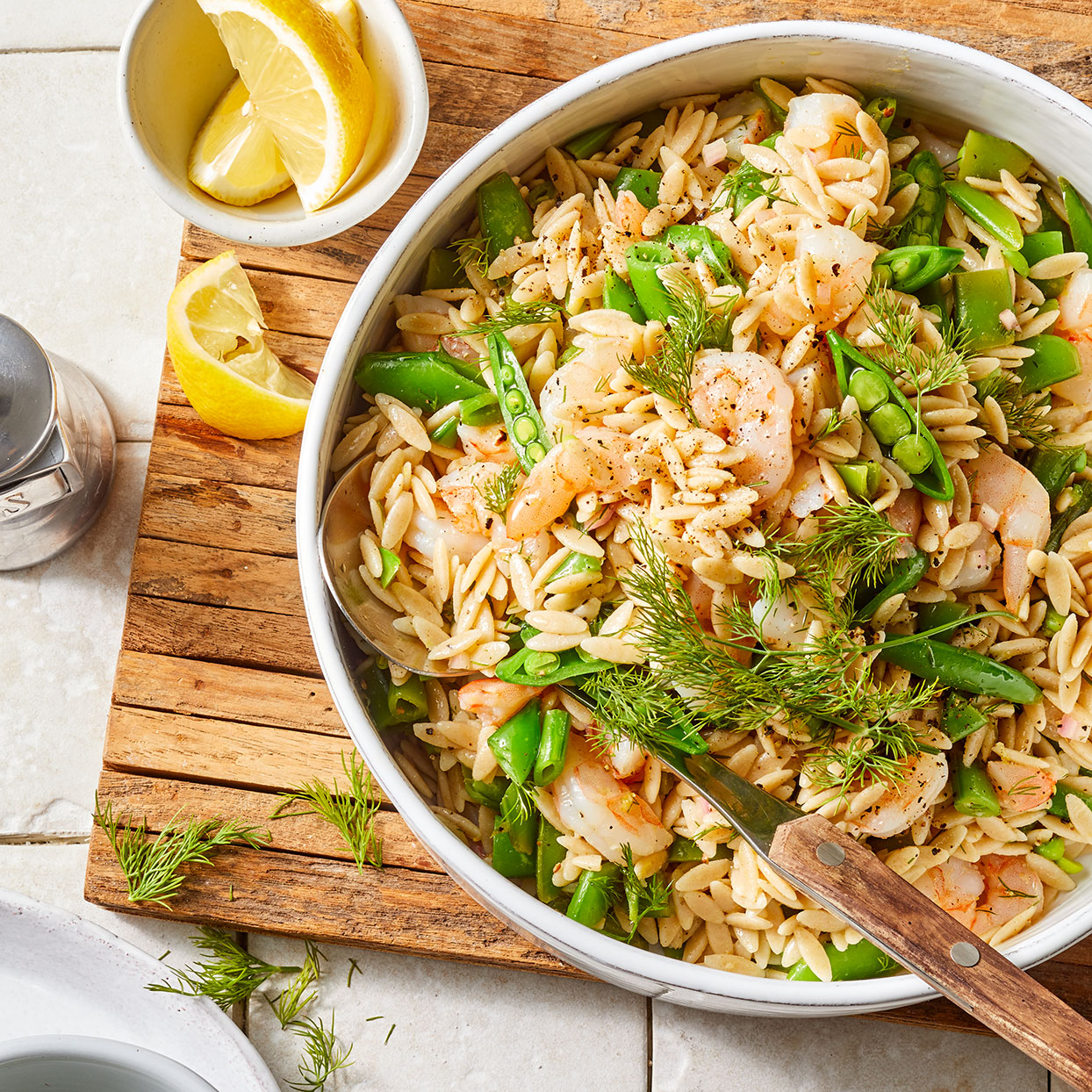 Consider making a double batch of this easy pasta salad--it's delicious the next day. The orzo will absorb the dressing as it sits, so add a little more olive oil and lemon juice if you'd like. Source: EatingWell Magazine, May 2020