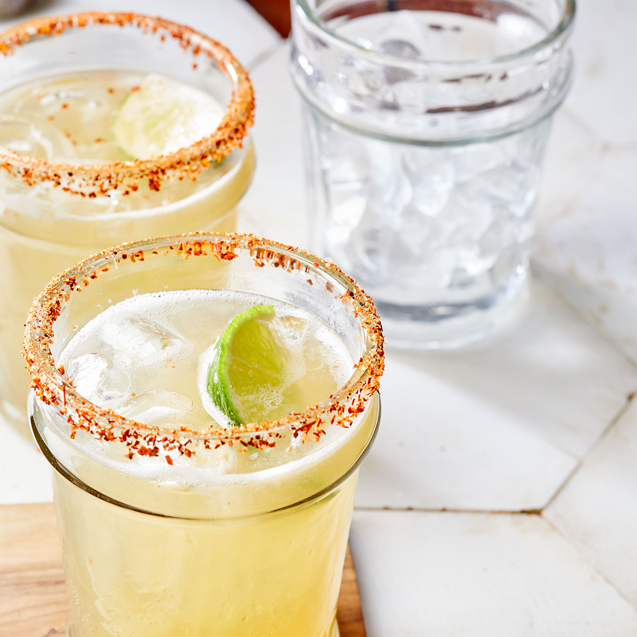 This easy margarita recipe is like vacation in a glass. A bit of the chile-lime seasoning Tajín on the rim of your glass contrasts with the sweet orange and agave. Source: EatingWell Magazine, May 2020