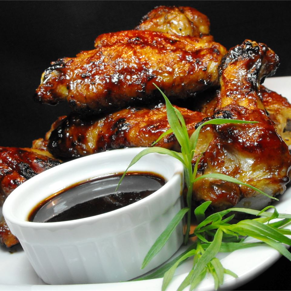 """These are wonderfully delicious, spicy, sweet, salty, sticky Asian-style chicken wings,"" says recipe creator Occasional Cooker. ""The garlic and ginger-spiced hoisin and teriyaki sauces, combined with the brown sugar and hot garlic chili sauce, make these wings fly off the platter! They make a great appetizer or light meal for watching the big game. They are excellent served with extra sauce as a dipping sauce or with an Asian slaw."""