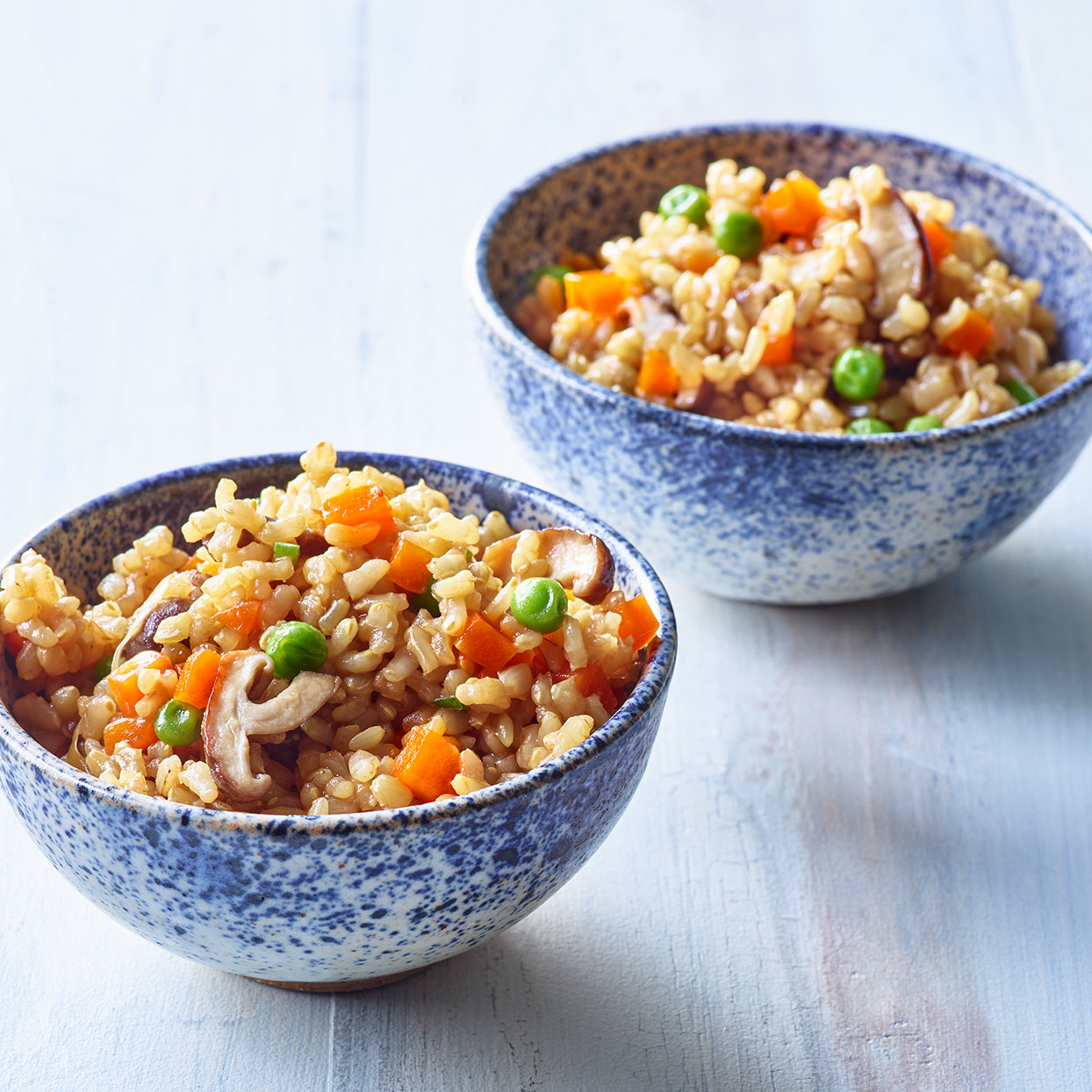 Dashi gives this vegetable rice recipe its savory depth. Rinsing the rice may seem like an extraneous step but it removes some of the surface starch for fluffier rice. And soaking the rice in seasoned dashi before cooking infuses the dish with more flavor. Source: EatingWell Magazine, May 2020