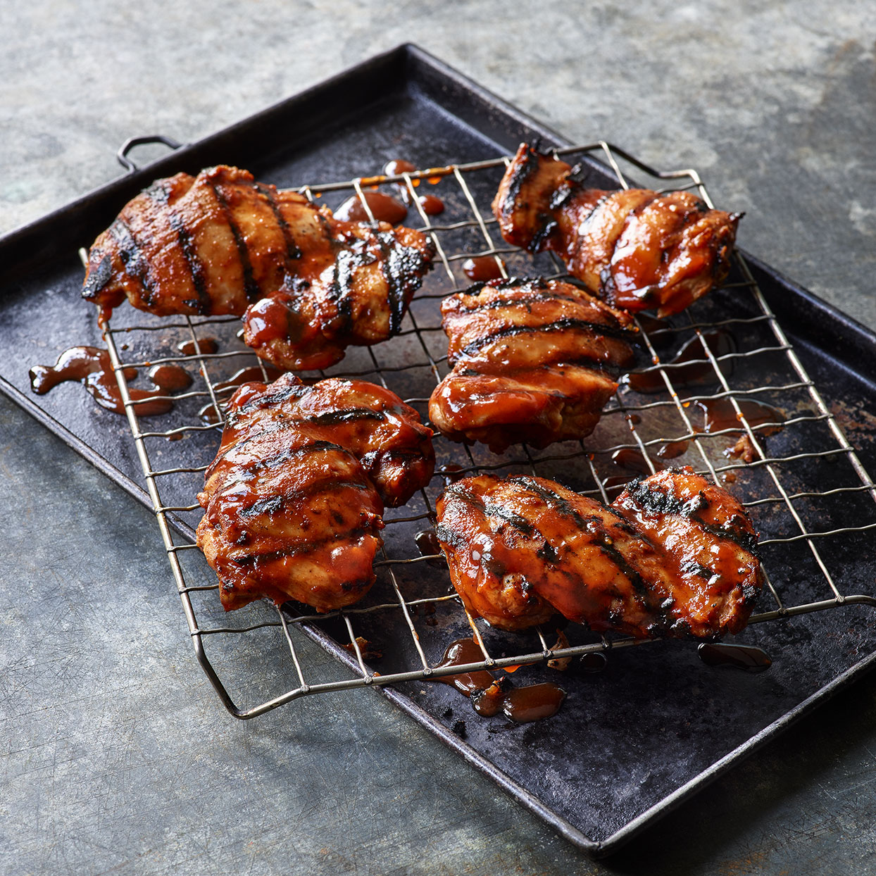This marinade is best on quick-cooking cuts of meat like this spicy grilled chicken, as the sugars in it can burn if on the grill for too long. Use the grill to cook the rest of your meal, too--Japanese eggplant and shishito peppers would be nice. Source: EatingWell Magazine, May 2020