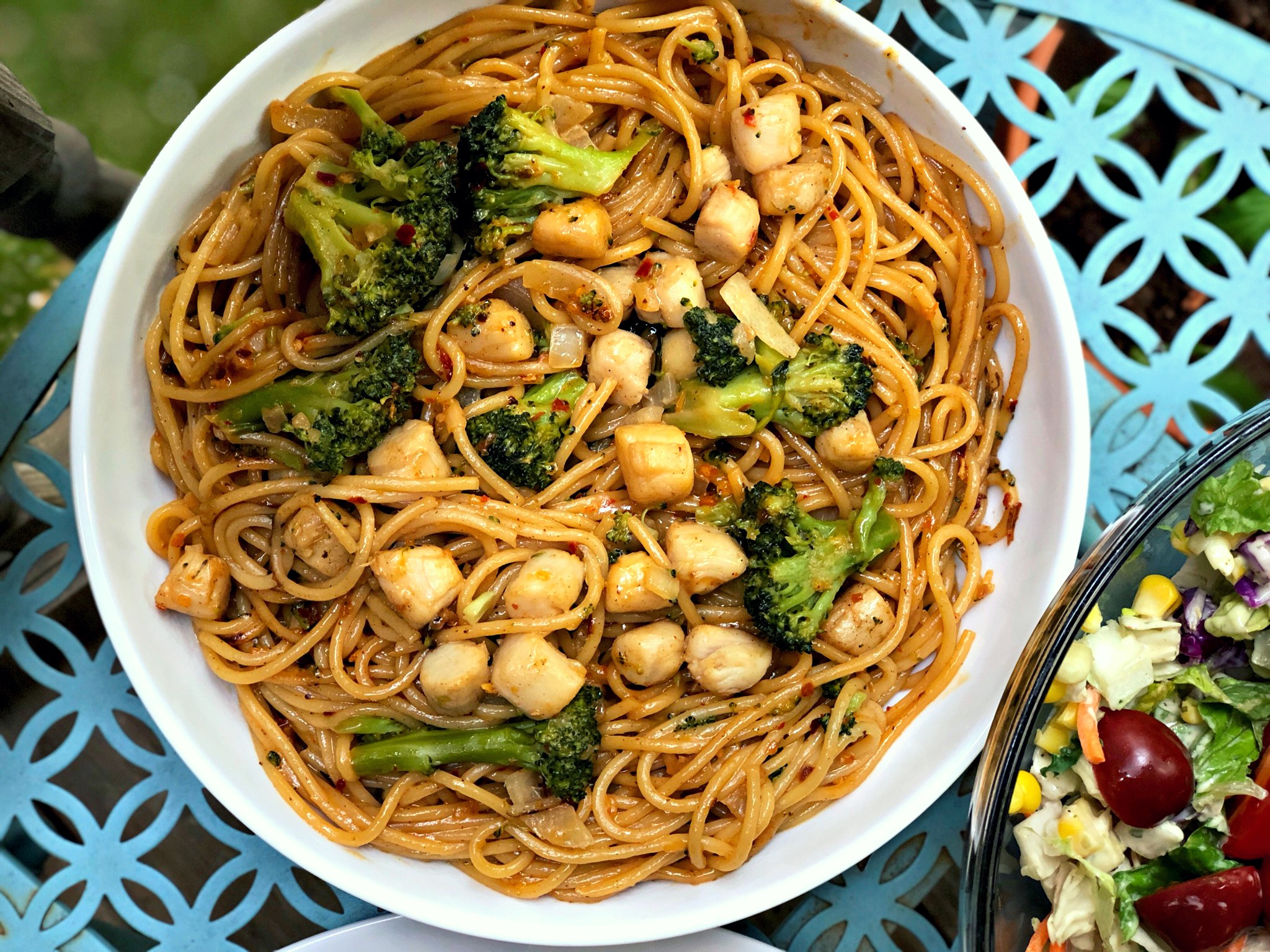 """A complete one-dish meal. """"This is one of my mom's favorite noodle dishes!"""" says Diana71. """"I've spiced it up a bit with more chili crisp than she would normally use, but it's worth it! The thin spaghetti noodles get an Asian flare, and the mini scallops add a wonderful but subtle seafood flavor. The broccoli is cooked perfectly since it is steamed first."""""""