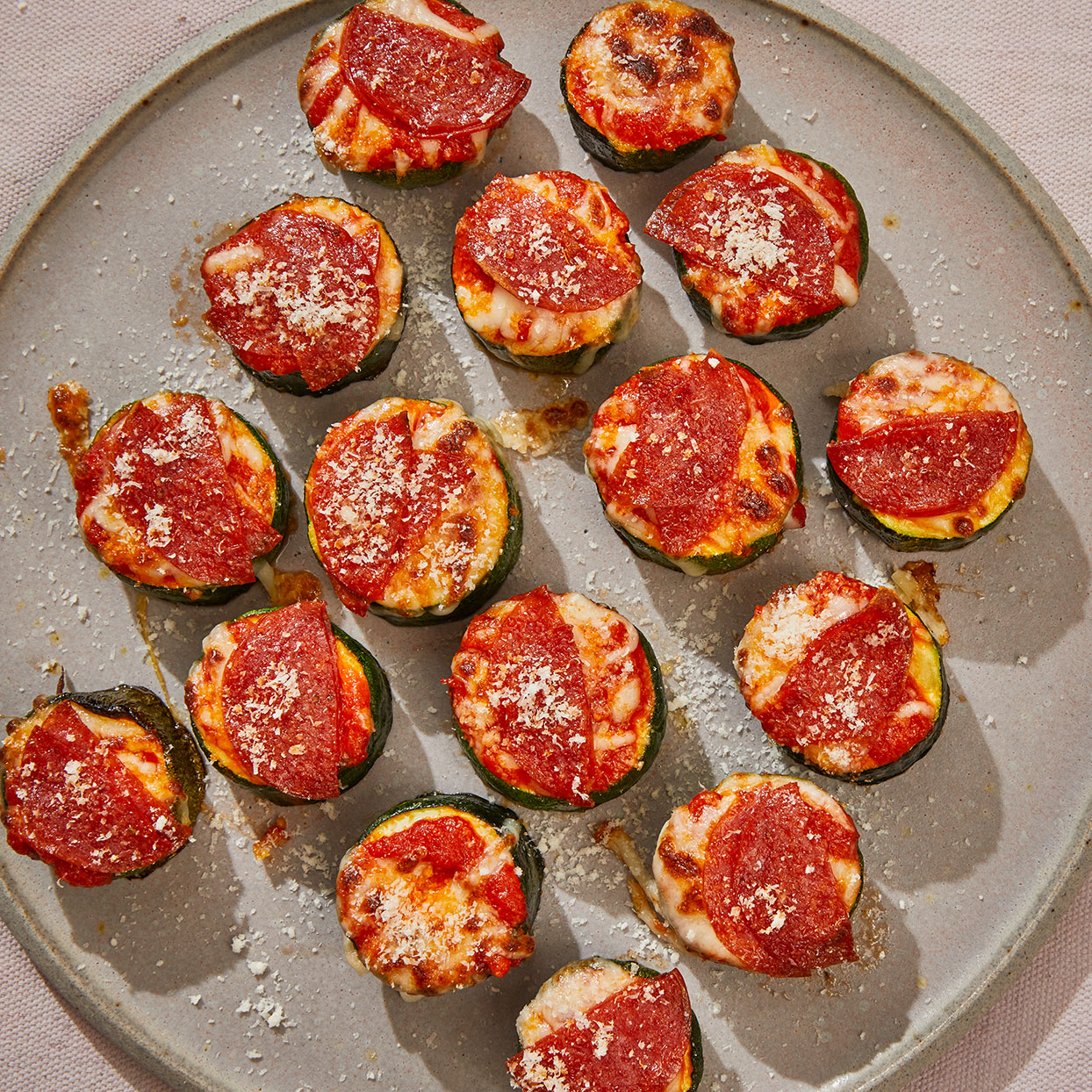 Think of these zucchini pizza bites as a fun gluten-free alternative to bagel bites. Be sure not to overcook the zucchini or the bites may become soggy. We like the classic pepperoni topping, but feel free to experiment with your own favorites. Source: EatingWell.com, April 2020