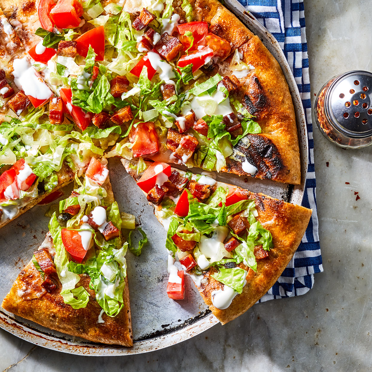 With pancetta, lettuce and tomato, this pie combines salad and pizza all in one, a pizz-alad if you will! It's a delicious mess--serve it with knives, forks and plenty of napkins. Source: EatingWell Magazine, June 2020