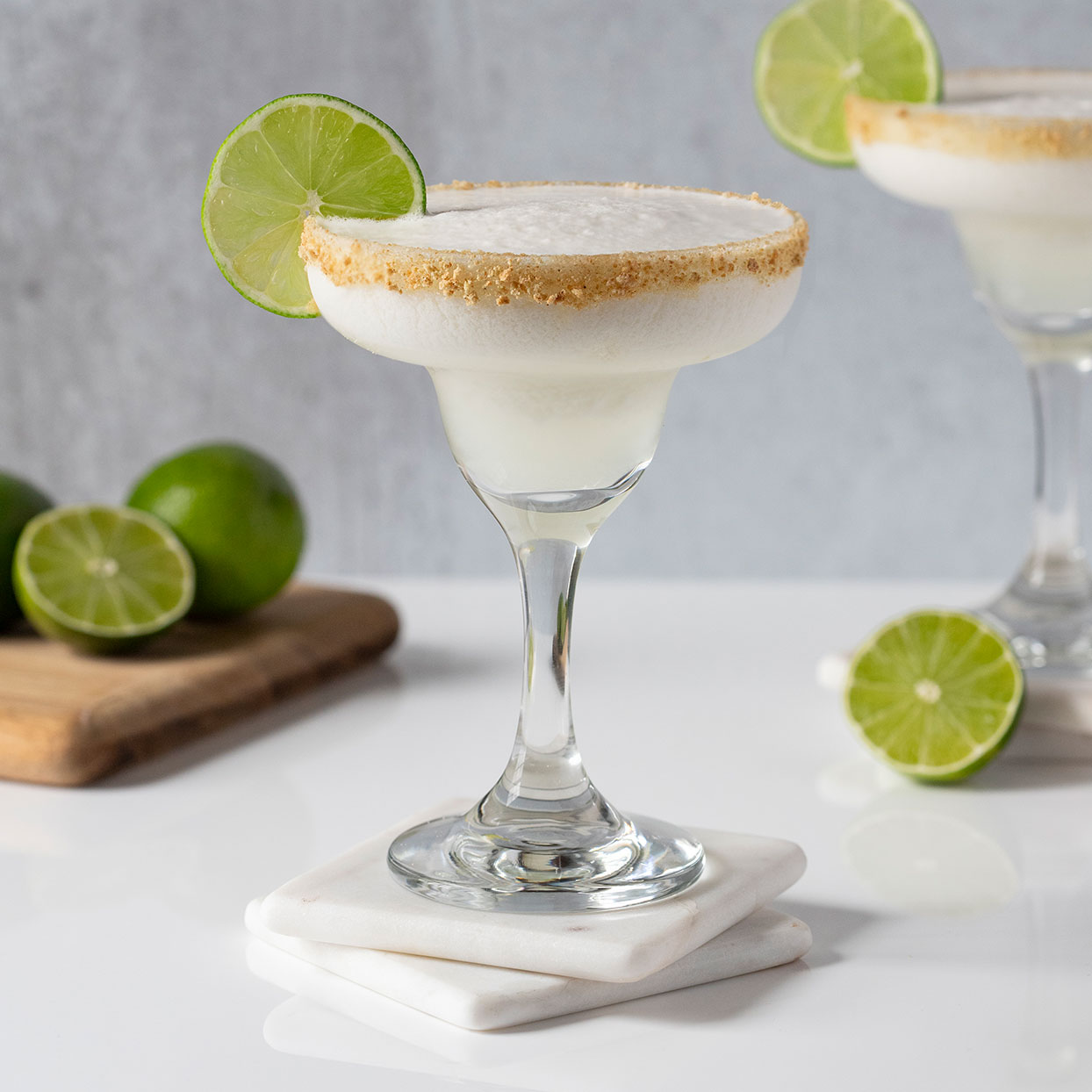 This frozen margarita was inspired by the flavors of a cool and creamy Key lime pie. Whip up a batch of these easy frozen margaritas when you want a sweet and refreshingly tart treat! Use Key limes—which have a wonderful floral aroma and flavor—if you can find them, but common limes work as well. Freshly squeezed juice will have the best flavor, but you can also find bottled Key lime juice—just be sure to buy unsweetened juice if you go for packaged juice. If you prefer a mocktail, simply replace the tequila with water.