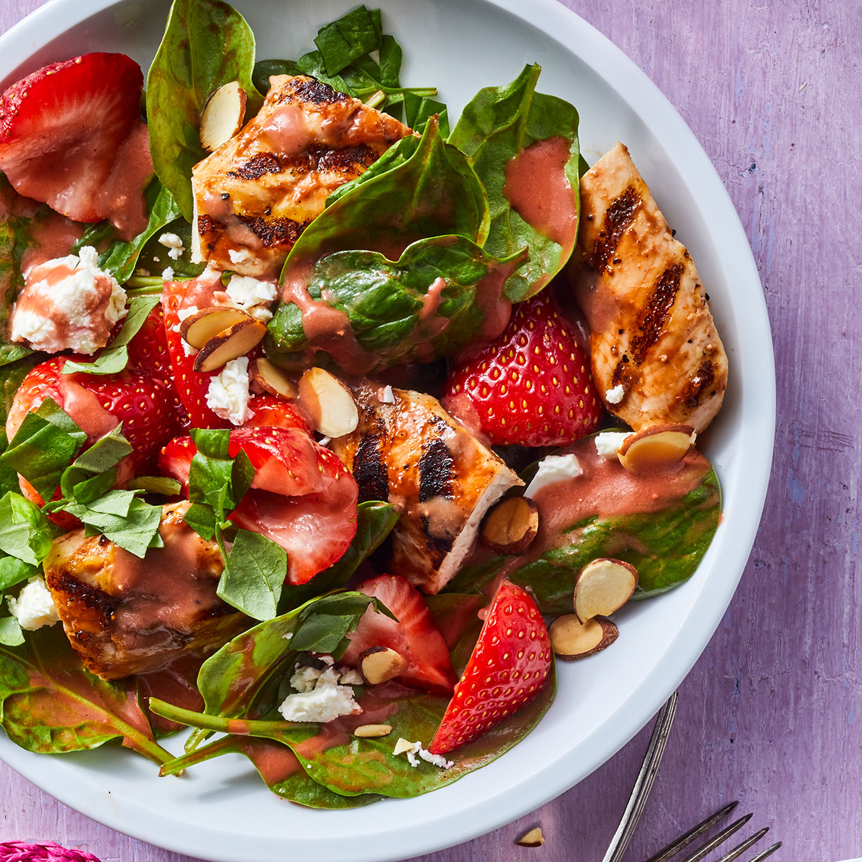 A quick blender vinaigrette does double duty as dressing for this strawberry spinach salad and, with the addition of ketchup and strawberry preserves, as a barbecue sauce for the tenders. Source: EatingWell Magazine, June 2020