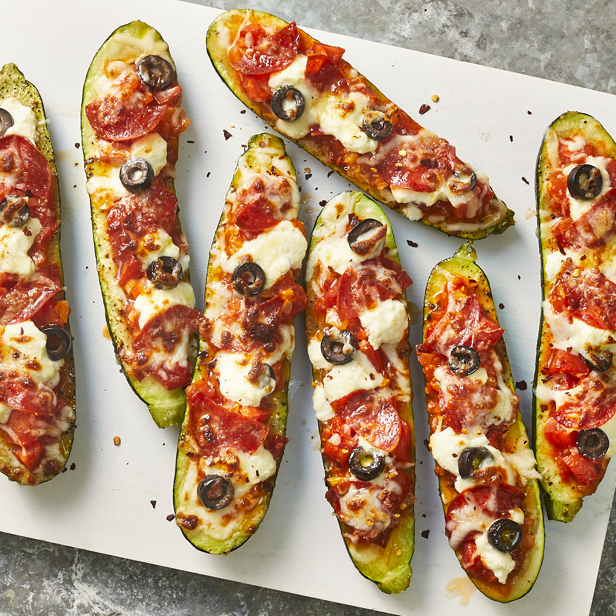 Turkey pepperoni, olives and diced tomato fill these stuffed zucchini boats. Ricotta and melted mozzarella cheese make this a fun twist on pizza without all the carbs. Source: EatingWell.com, May 2020