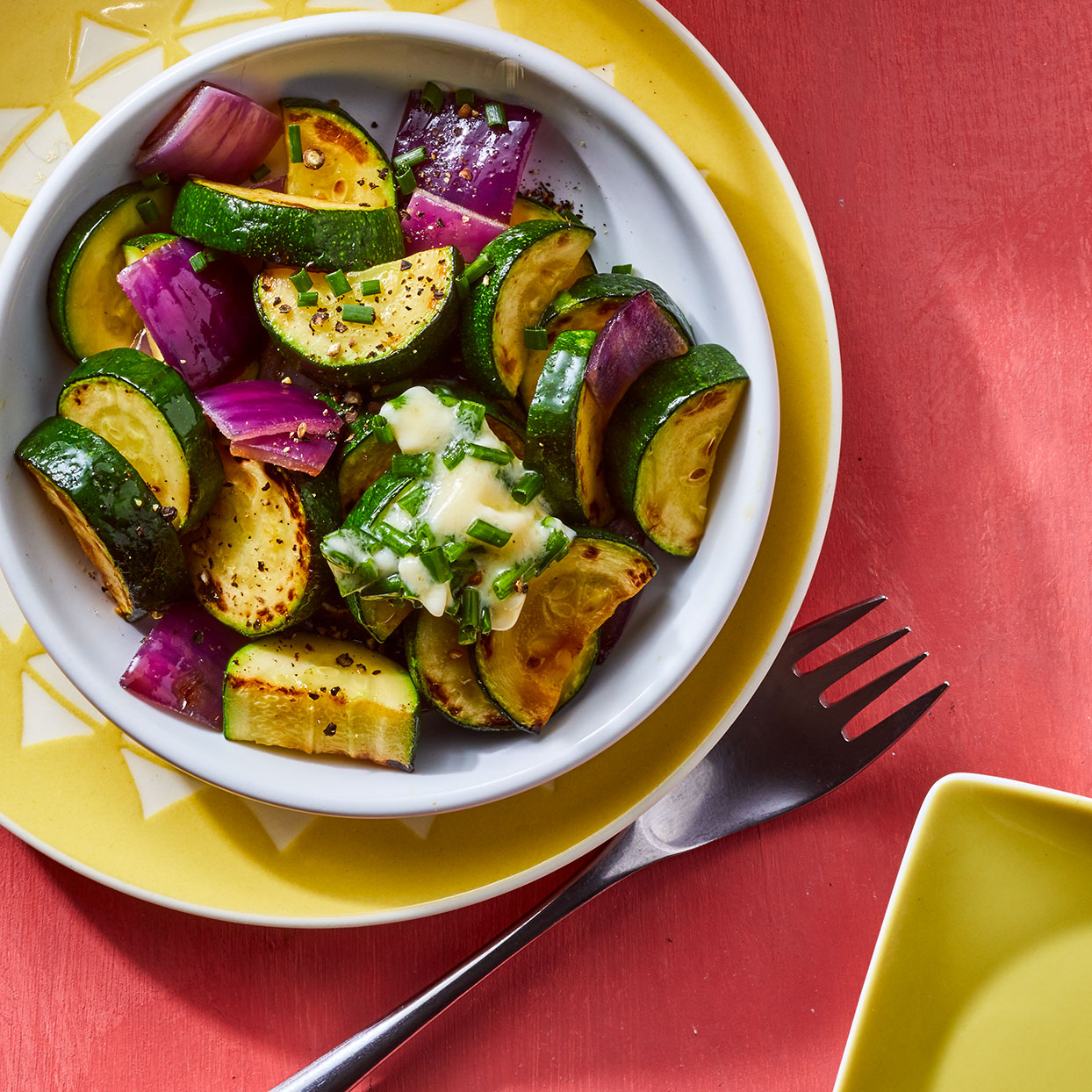 Switch up the chives for whatever's growing in your garden--basil or dill would also be delicious in the compound butter that tops this simple sautéed zucchini recipe. Source: EatingWell Magazine, June 2020