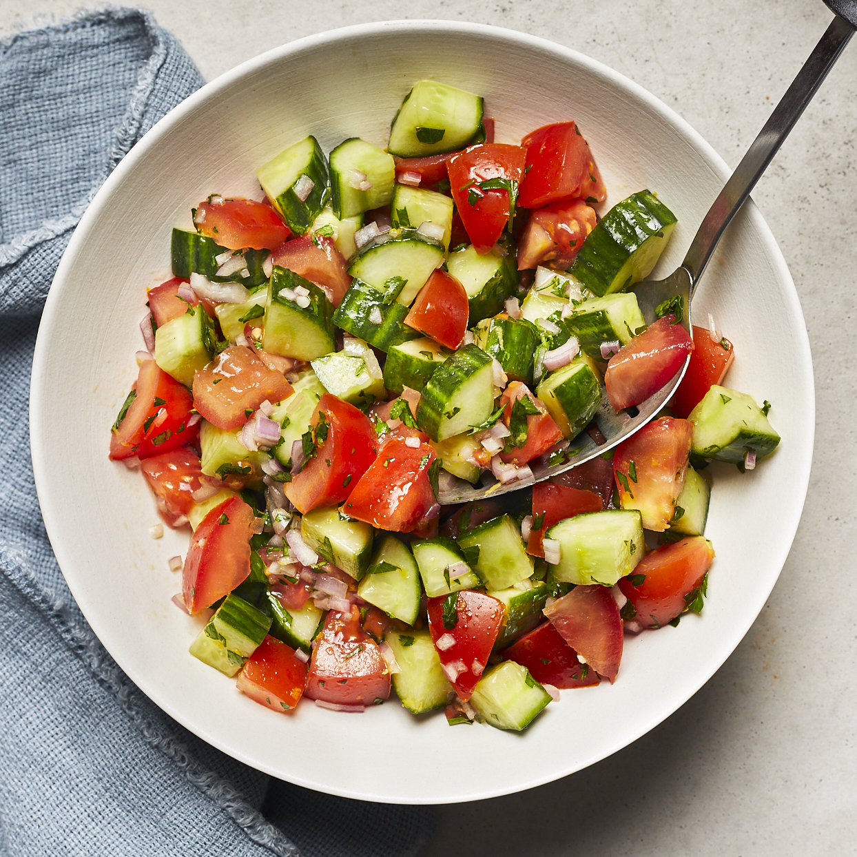 It doesn't get easier than a cucumber and tomato summer salad! Fresh cucumber and juicy ripe tomatoes are all you need to really make this salad shine. Marinating cucumbers and tomatoes in vinegar with a touch of lemon zest infuses the dish with tangy citrus flavor. Source: EatingWell.com, May 2020