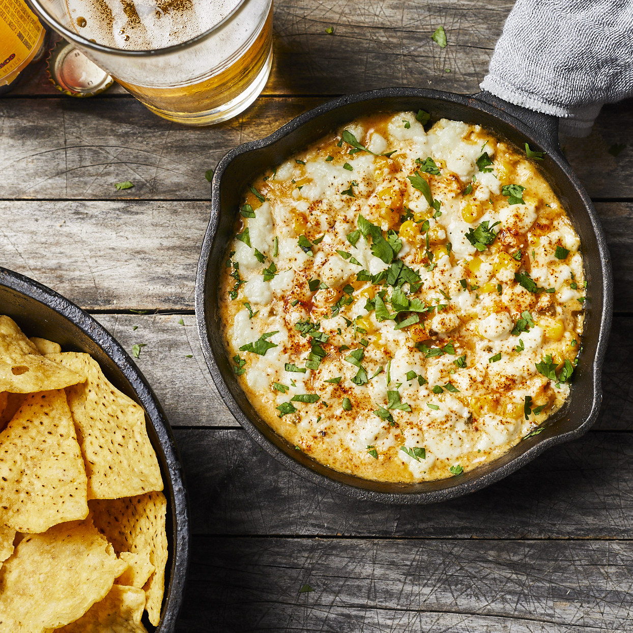 Serve this Mexican street corn dip at your next summer party. Creamy melted cheese brings sweet corn and spicy jalapeño together with a nice pop of brightness from lime juice and cilantro. This creamy and satisfying dish can be served with tortilla chips and veggies for dipping. Source: EatingWell.com, May 2020