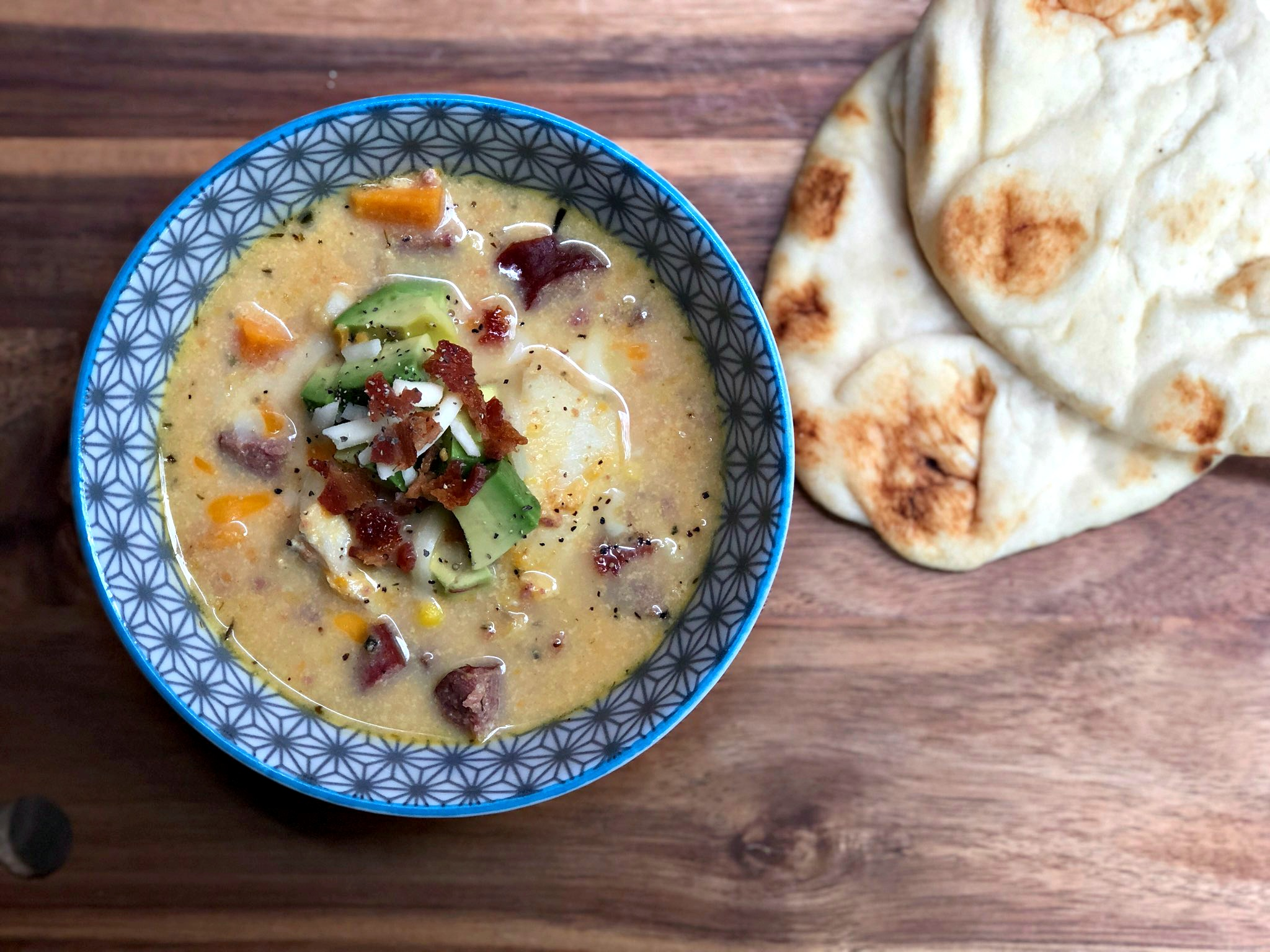 """""""This is a lighter scallop and tilapia chowder that's loaded with veggies (sweet potatoes, corn, bell peppers),"""" says Diana71. """"It still has the rich and creamy textures, but is healthier given the lack of heavy cream and the use of sweet potatoes."""""""