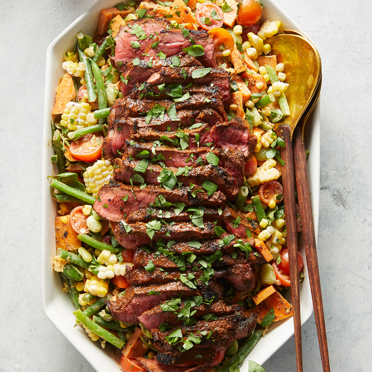 A summer salad through and through! Grilled sweet potatoes and grilled sirloin steak add just enough smokiness without overpowering all of the fresh flavors, while a creamy lime dressing brings everything together. Source: Diabetic Living Magazine, Summer 2020