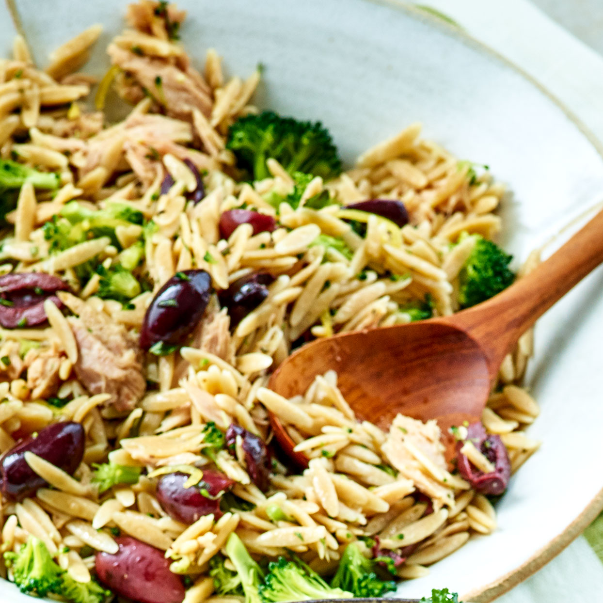 This pasta- and tuna-salad mashup gets a boost of color and texture from broccoli. Plenty of Kalamata olives add a briny bite. Be sure to monitor the pasta-cooking carefully, as orzo can go from al dente to mush in a minute. If in doubt, drain it a little early--it'll soften further in the lemon dressing. Source: EatingWell Magazine, June 2020