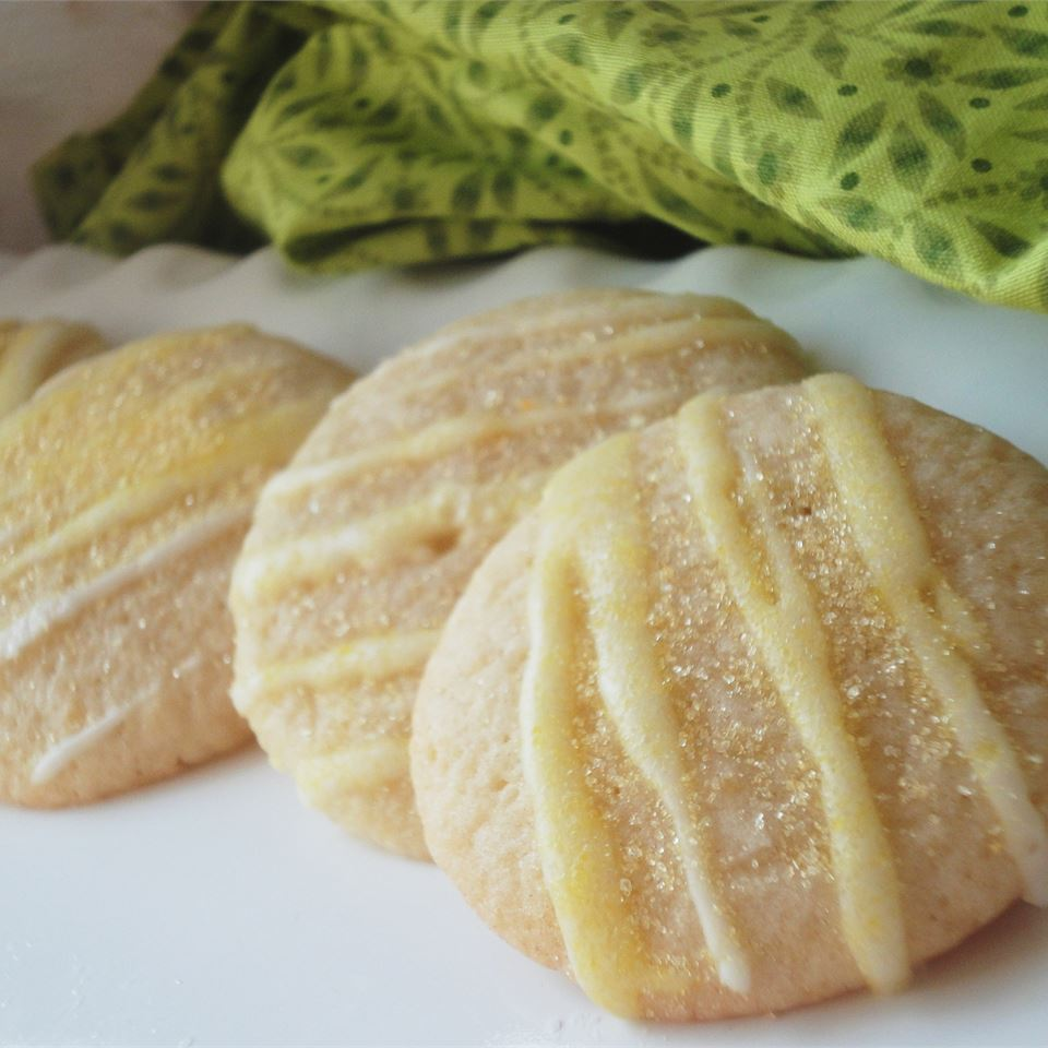This is a delicious little lemon cookie that is perfect for springtime (or anytime)! They can either be drizzled with a lemon glaze that is made with confectioners sugar and fresh lemon juice, or you can roll them in sugar before baking for a more mild lemon flavor.