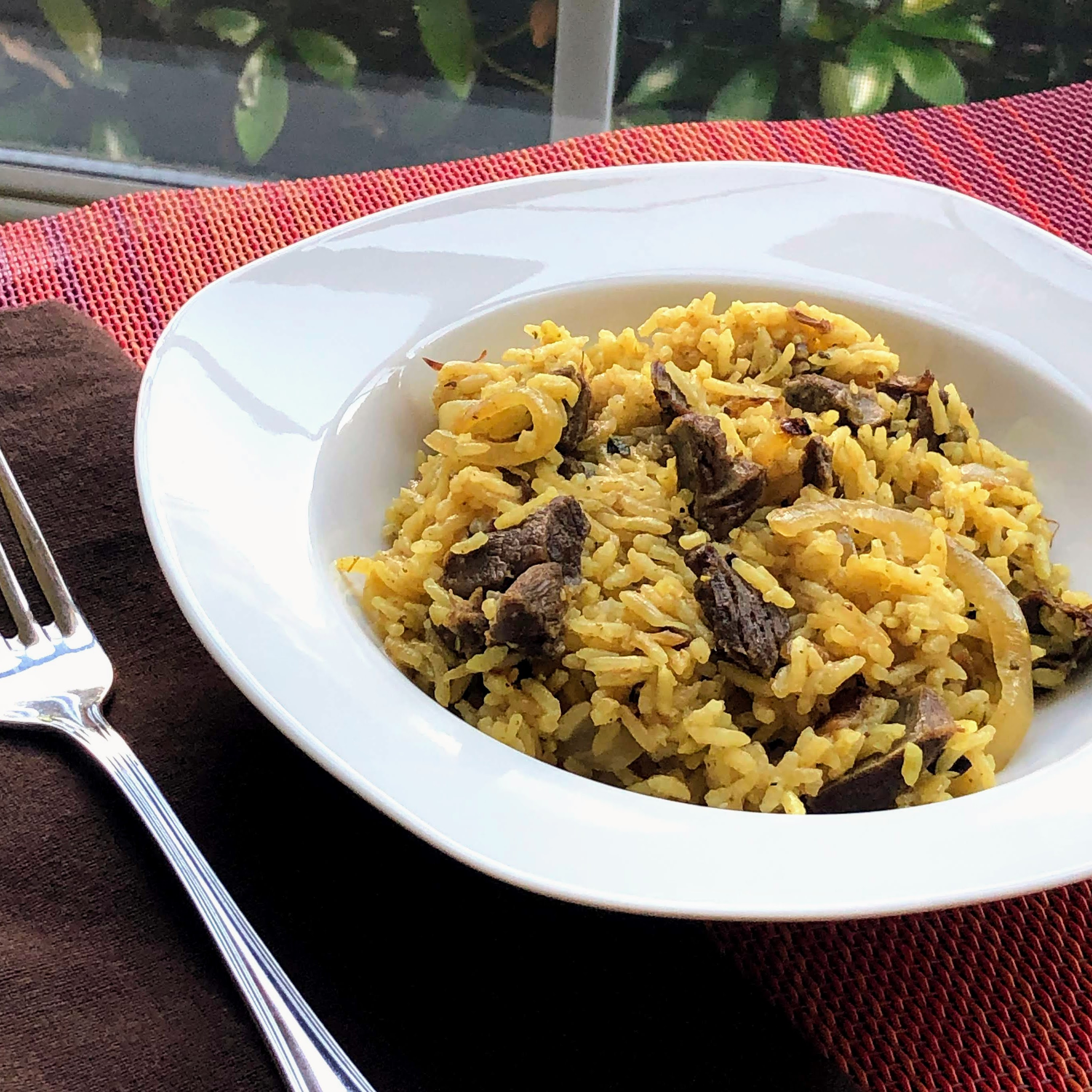 Spicy Goat Curried Rice Pilaf