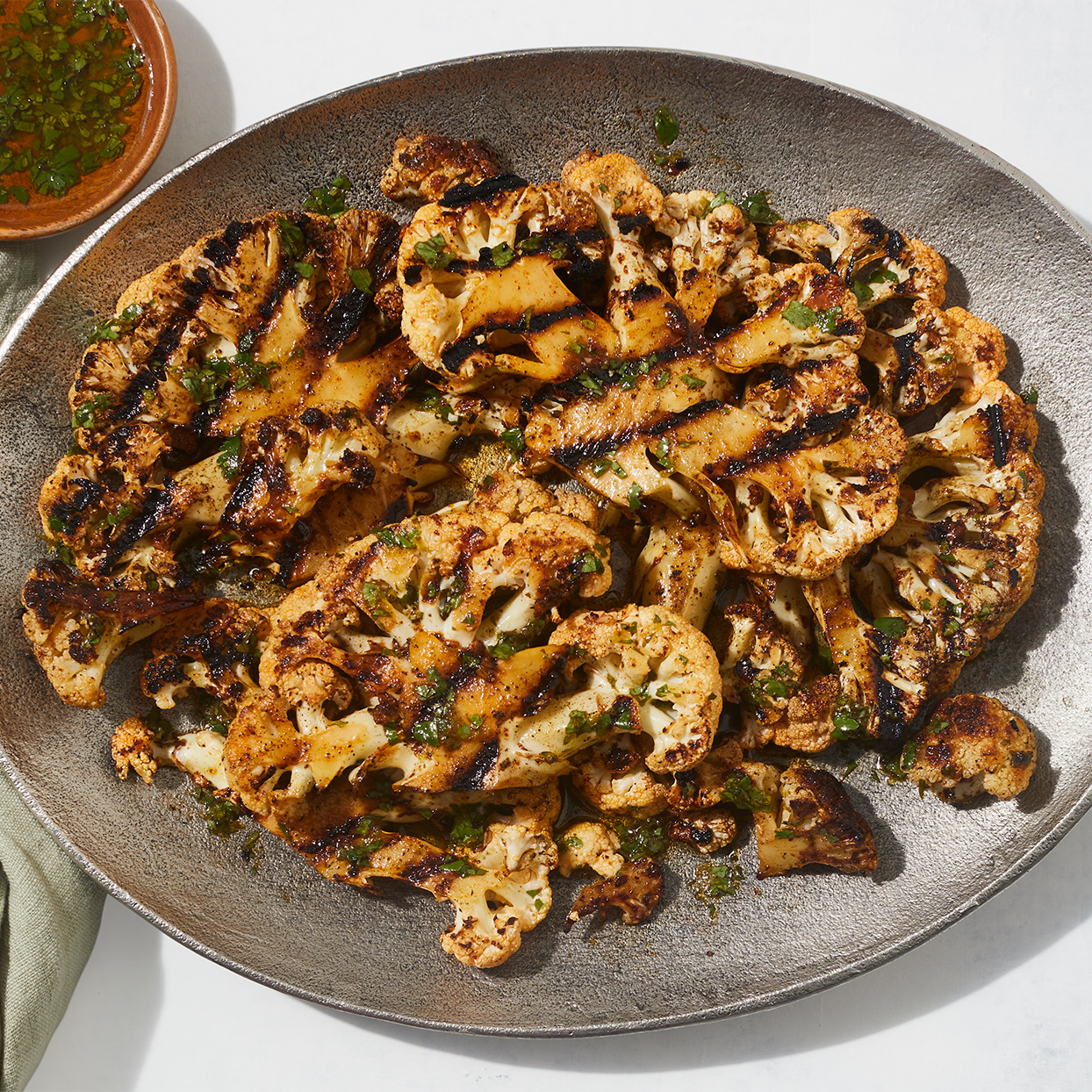Cauliflower's round shape can be cut into slabs or florets for the grill. Here, it's grilled both ways after being rubbed with a blend of spicy seasonings and basted with a fresh cilantro-lime vinaigrette. Source: Diabetic Living Magazine, Summer 2020