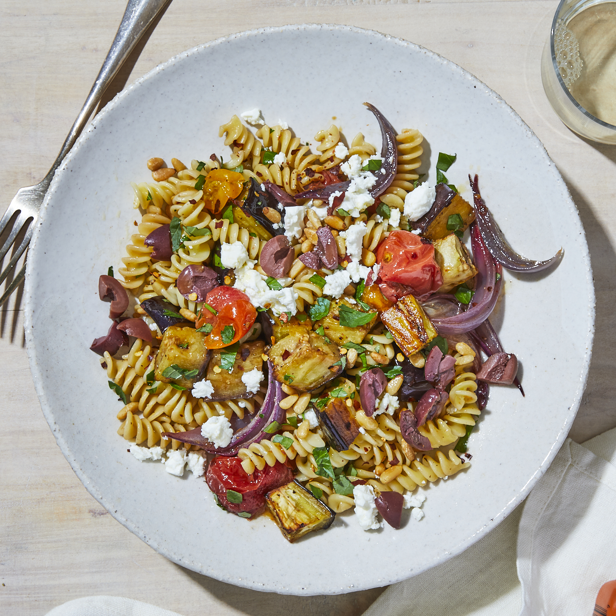This easy roasted eggplant pasta dish is dressed with eggplant, fresh cherry tomatoes and plenty of fresh herbs. Feta cheese adds a savory note while the balsamic dressing brightens the flavor. It's the perfect summer vegetarian dinner. Source: EatingWell.com, May 2020