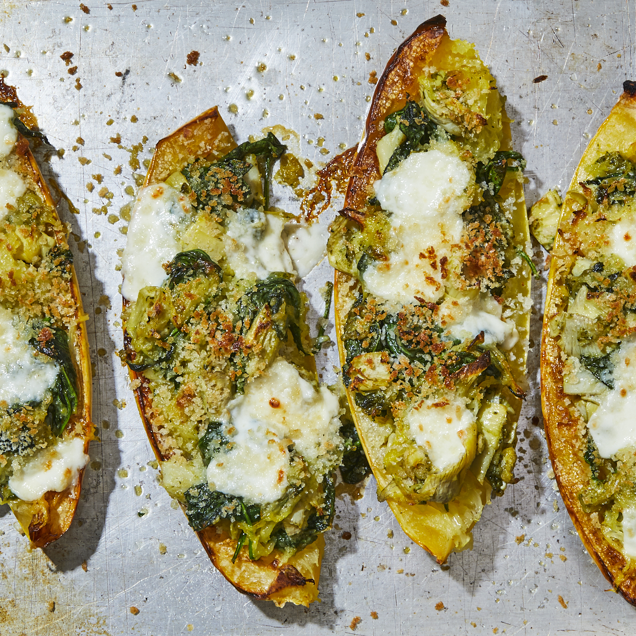 This delicious, cheesy, full-flavored pesto-stuffed spaghetti squash is hearty and filling, full of vegetables and topped with melted fresh mozzarella cheese. It's a perfect main dish for vegetarians and nonvegetarians alike! Source: EatingWell.com, May 2020