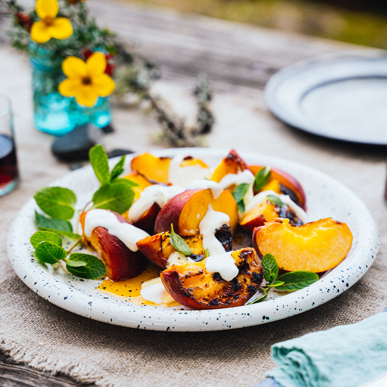 Here's a new idea for dessert on a camping trip or in the backyard. Because you don't need the recipe for s'mores. But you could totally crumble some graham crackers on top to add some crunch to these grilled peaches. Source: EatingWell Magazine, June 2020