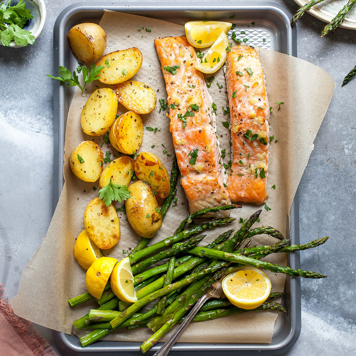 This spring-produce-packed one-pan meal makes a healthy and satisfying weeknight dinner. Melted garlic butter coats the salmon and vegetables, adding depth of flavor and richness to the dish. Source: EatingWell.com, May 2020