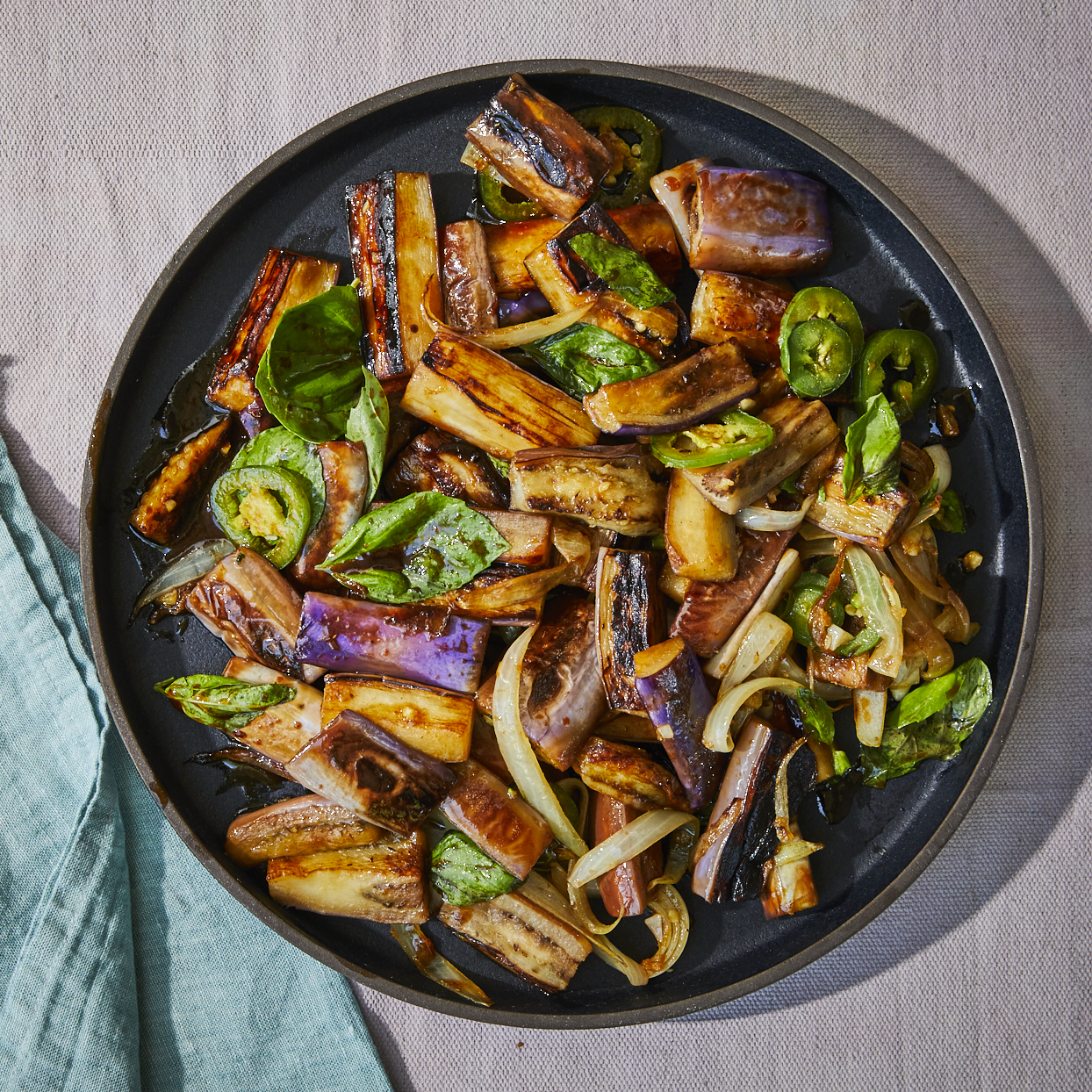 This eggplant stir-fry is easy to make. We call for long and tender Japanese eggplant, but regular eggplant will work well too, cut into 1-inch pieces. Jalapeño peppers can vary from mild to very spicy. If you need to cut the heat, opt for small sweet peppers in their place. Source: EatingWell.com, May 2020