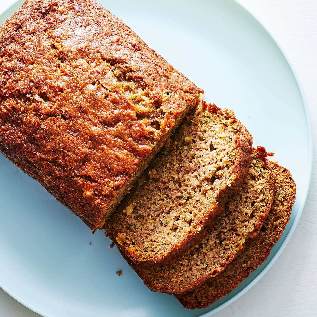 This easy zucchini-pineapple bread is the perfect healthy breakfast treat! Saving the pineapple juice strained from the can to brush on top of the bread keeps it moist and adds more pineapple flavor. Source: EatingWell.com, May 2020