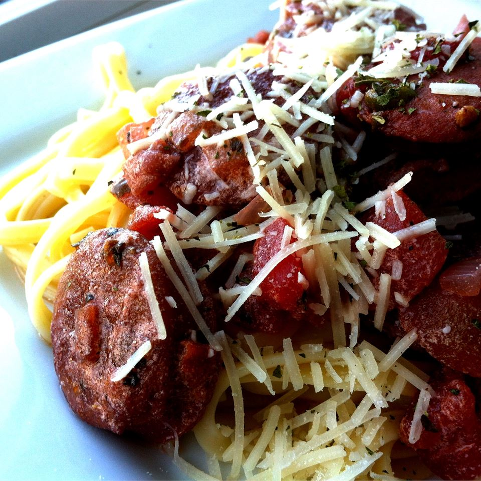 Grilled Sweet Italian Chicken Sausage with Tomato Cream Sauce Over Linguine