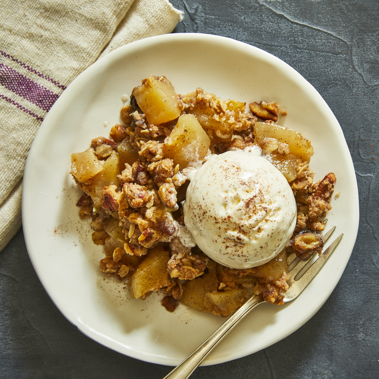 Apple crisp in your Instant Pot?! Yes, you can! This easy Instant-Pot apple crisp has a nice balance of flavors from lemon zest and juice, brown sugar and sweet Honeycrisp apples. The whole-wheat flour and pecans add texture to the topping, which remains moist and delicious as it melds with the other flavors. To keep the texture from getting mushy, be sure not to cut the apple pieces too small. One-inch cubes will do the trick!