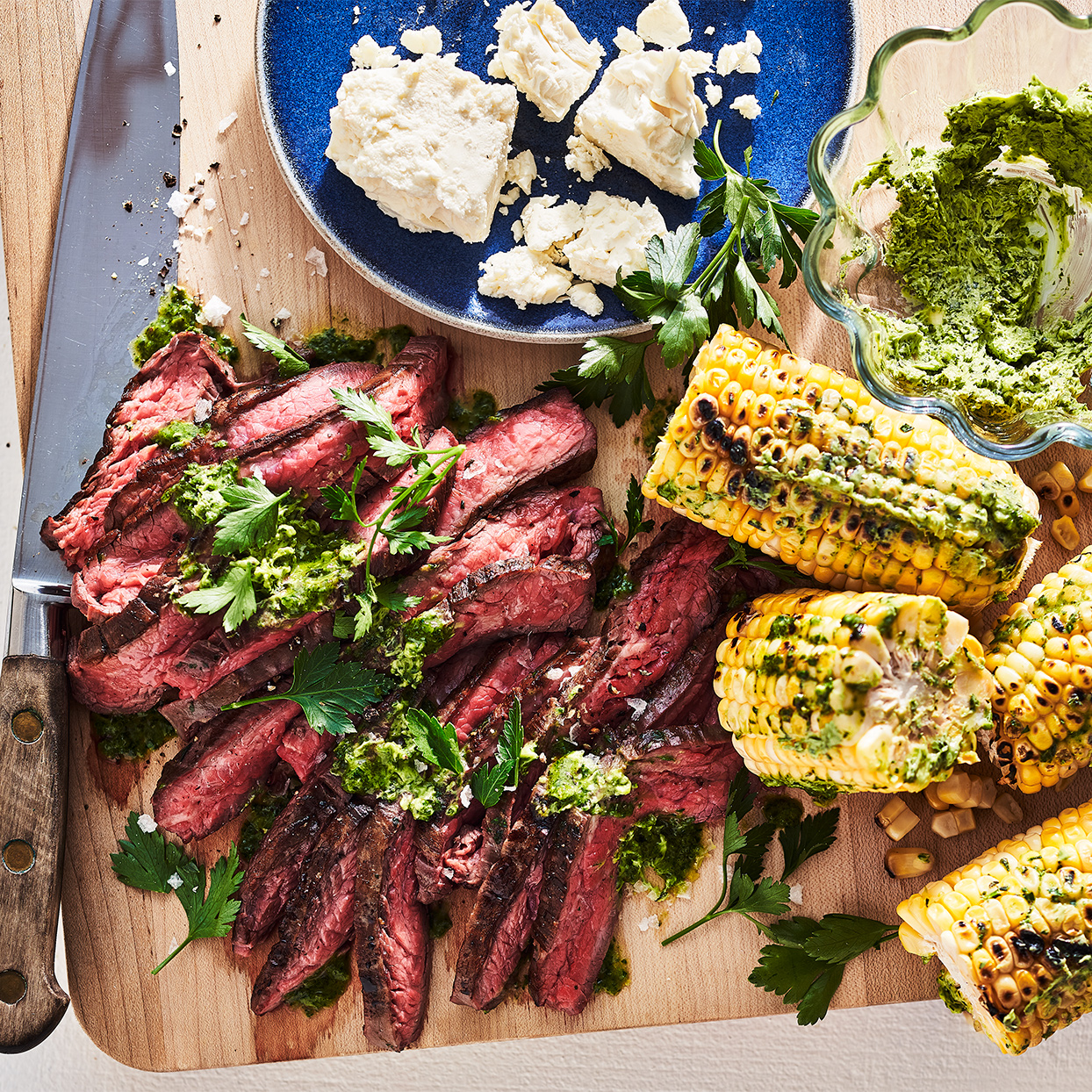 An herbaceous butter turns grilled sweet corn into a rave-worthy accompaniment to simple grilled flank steak.Source: EatingWell Magazine, July / August 2020