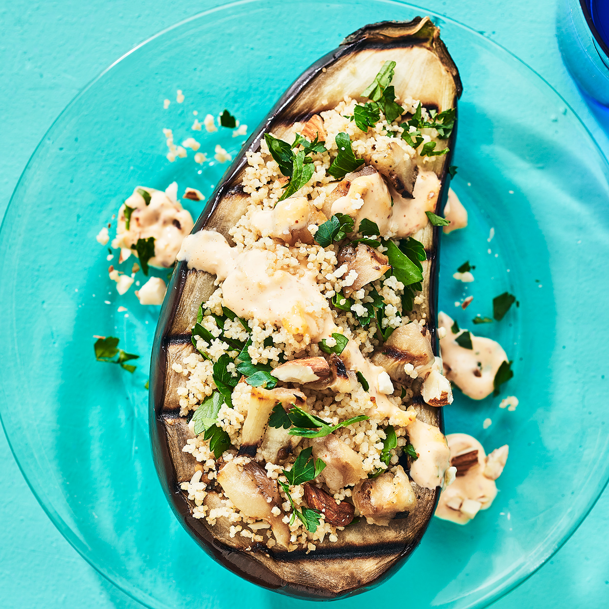 Smoky almonds, meaty eggplant and whole-grain couscous with herbs make this meal plenty satisfying. Harissa gives the creamy sauce a little kick. Source: EatingWell Magazine, July / August 2020