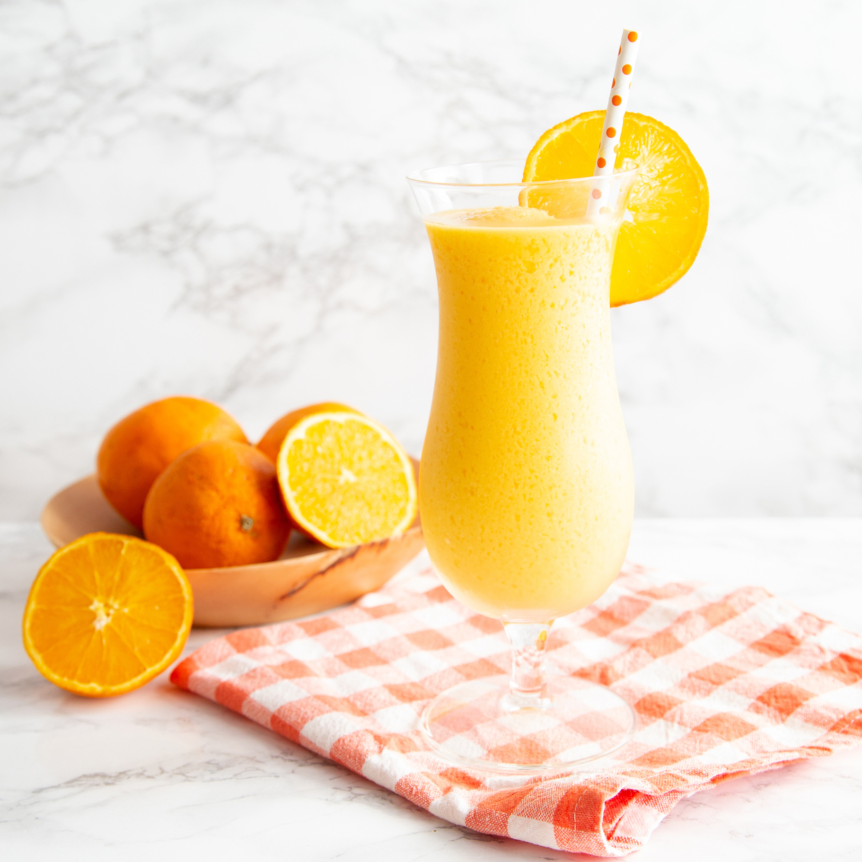 For those of you who always loved to run to the curb to buy a little bit of summer on a stick, this drink is right up your alley. The secret to the straight-from-the-ice-cream truck taste of this creamy frozen treat? Double the fruit! A little bit of frozen mango helps thicken the drink naturally in the blender while boosting the juicy flavor of fresh orange juice. Unsweetened vanilla coconut milk brings just a hint of sweetness while keeping this added-sugar-free and vegan. You could also use a sweetened coconut milk if you prefer a little more sweetness. Enjoy this refreshing and nostalgic drink on its own, or add a splash of your favorite vodka or rum for a summer happy hour indulgence. P.S.: Unlike the ice cream version, this one travels well in an insulated cup if you want to take it poolside! Source: EatingWell.com, June 2020