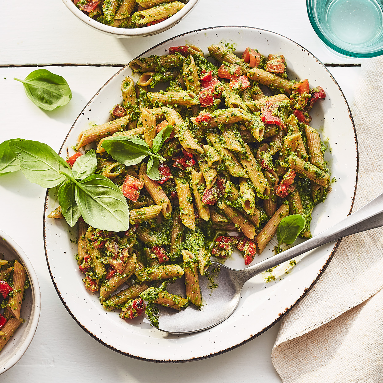 This cold pesto pasta salad will cool you off on a summer day. Fresh tomatoes and roasted red peppers add a pop of bright color and juiciness here, but any of your favorite pasta-salad veggies, like blanched broccoli and fresh bell peppers, would be delicious too. Source: EatingWell Magazine, July / August 2020
