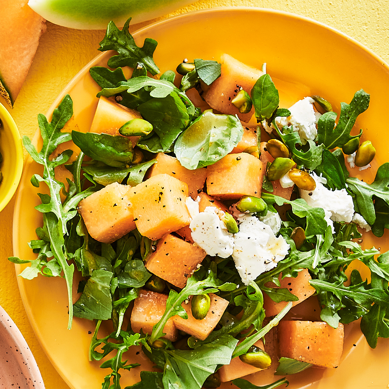 Buy a melon that feels heavy for its size and smells slightly sweet. Picking a ripe one ensures the right balance of flavors in this arugula and goat cheese salad.