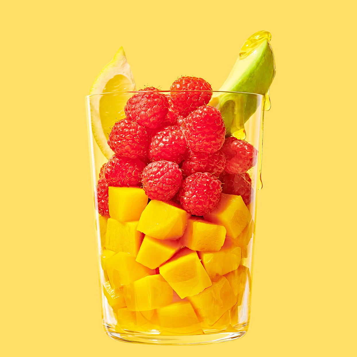 A squeeze of lemon juice adds bright flavor to this frozen fruit smoothie. Mango provides plenty of sweetness without having to add juice, but if it's too tart for you, a touch of agave will do the trick.