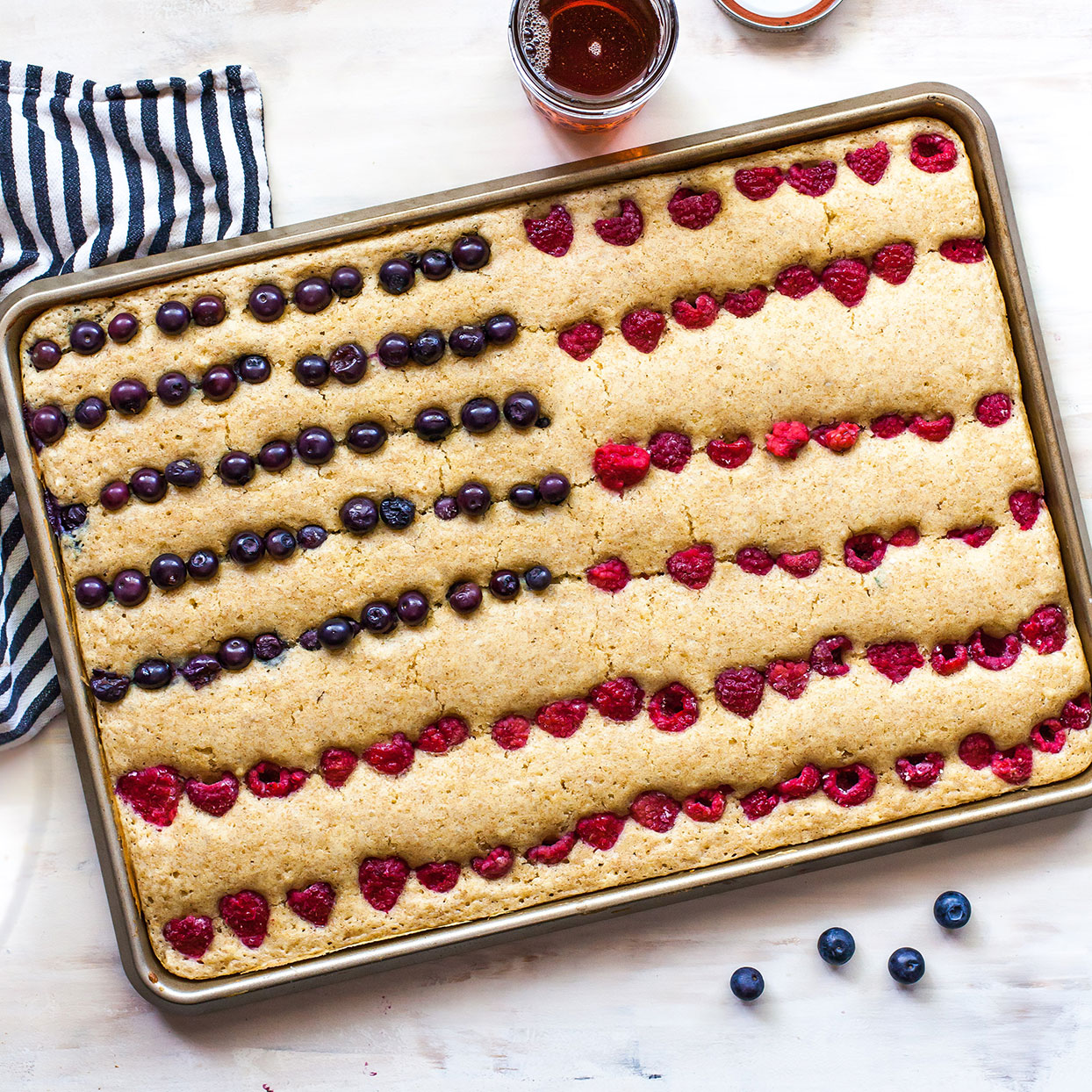 Get your Fourth of July off to the right start with this patriotic sheet-pan pancake! It's fun and easy to decorate with fresh summer fruit. Depending on the thickness of your batter, the fruit may slip under the surface while baking. Check it toward the end of the baking time and add more fruit to the top if needed. Source: EatingWell.com, June 2020