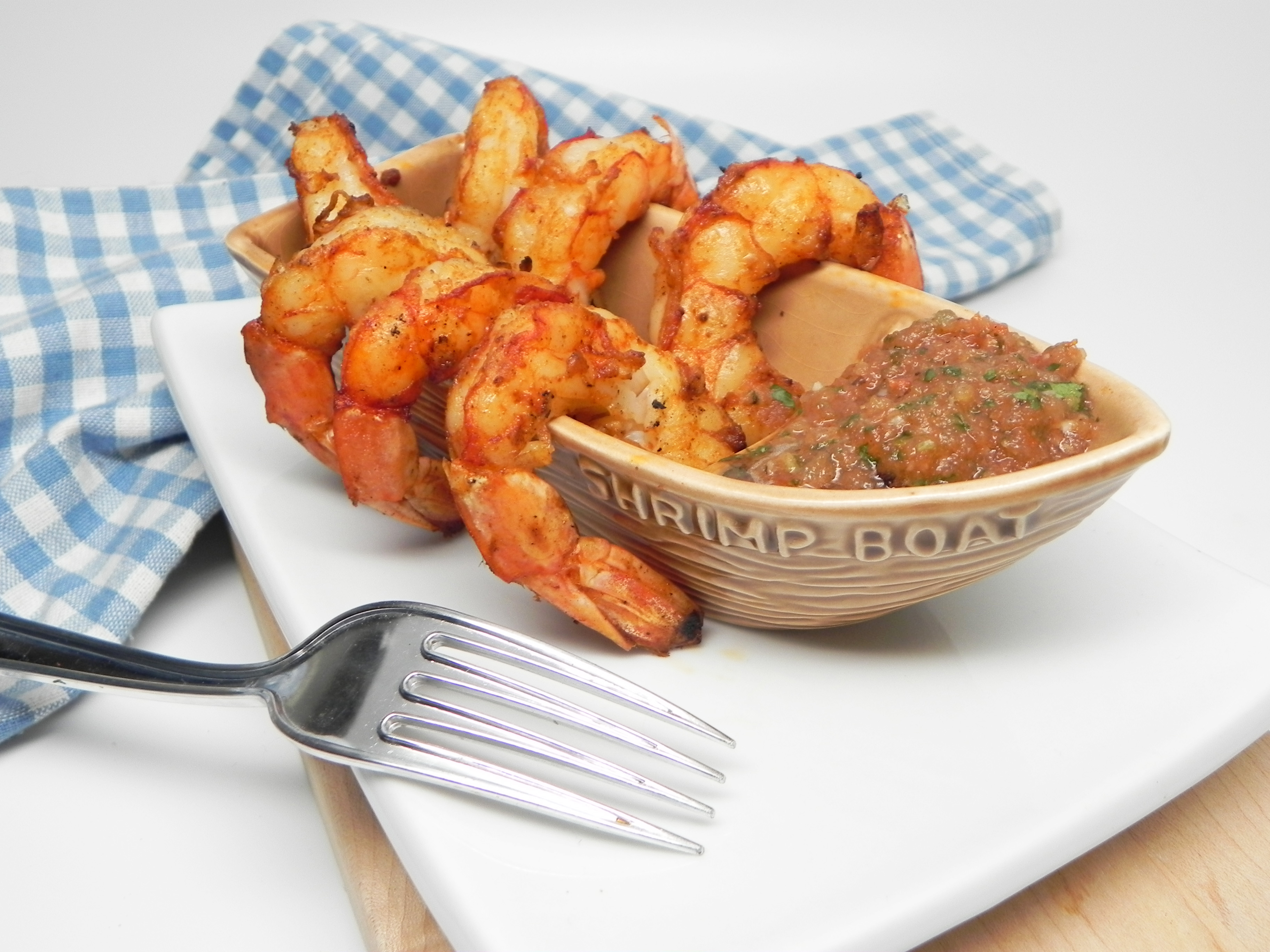 """Seasoned jumbo shrimp, grilled, and served with a homemade grilled salsa. """"I serve this as a main dish but it would make a great appetizer as well,"""" says Soup Loving Nicole."""