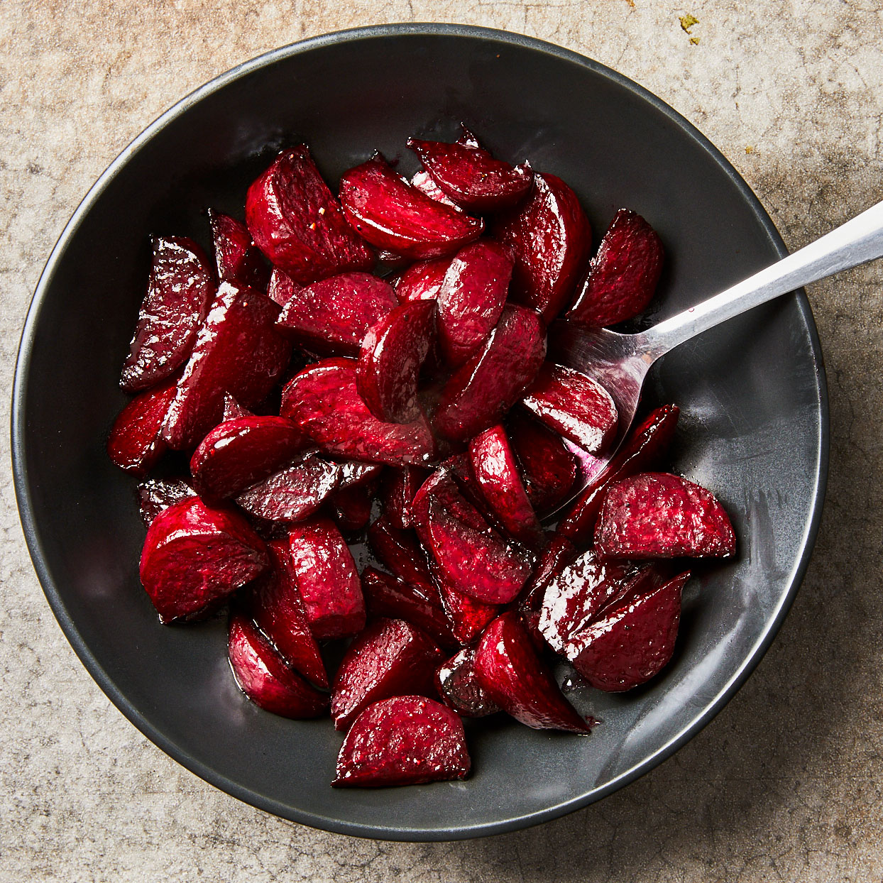 Earthy beets turn sweet and tender when they're roasted. Preheating your baking sheet speeds up the roasting time and gives the outside of the beets a quick and flavorful sear. Honey and lemon juice add sweet and tangy notes.Source: EatingWell.com, July 2020