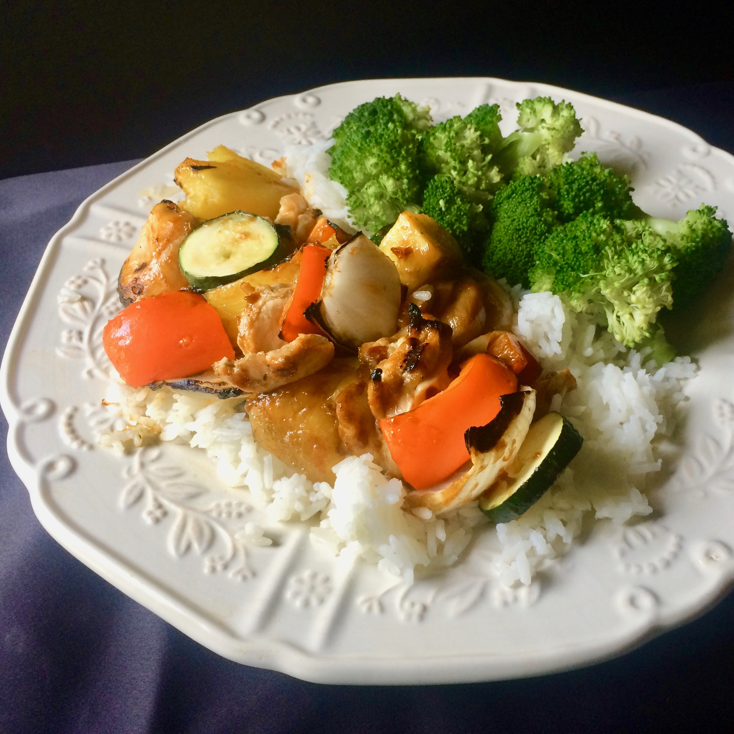 Grilled Orange Chicken Thigh Skewers with Pineapple and Vegetables