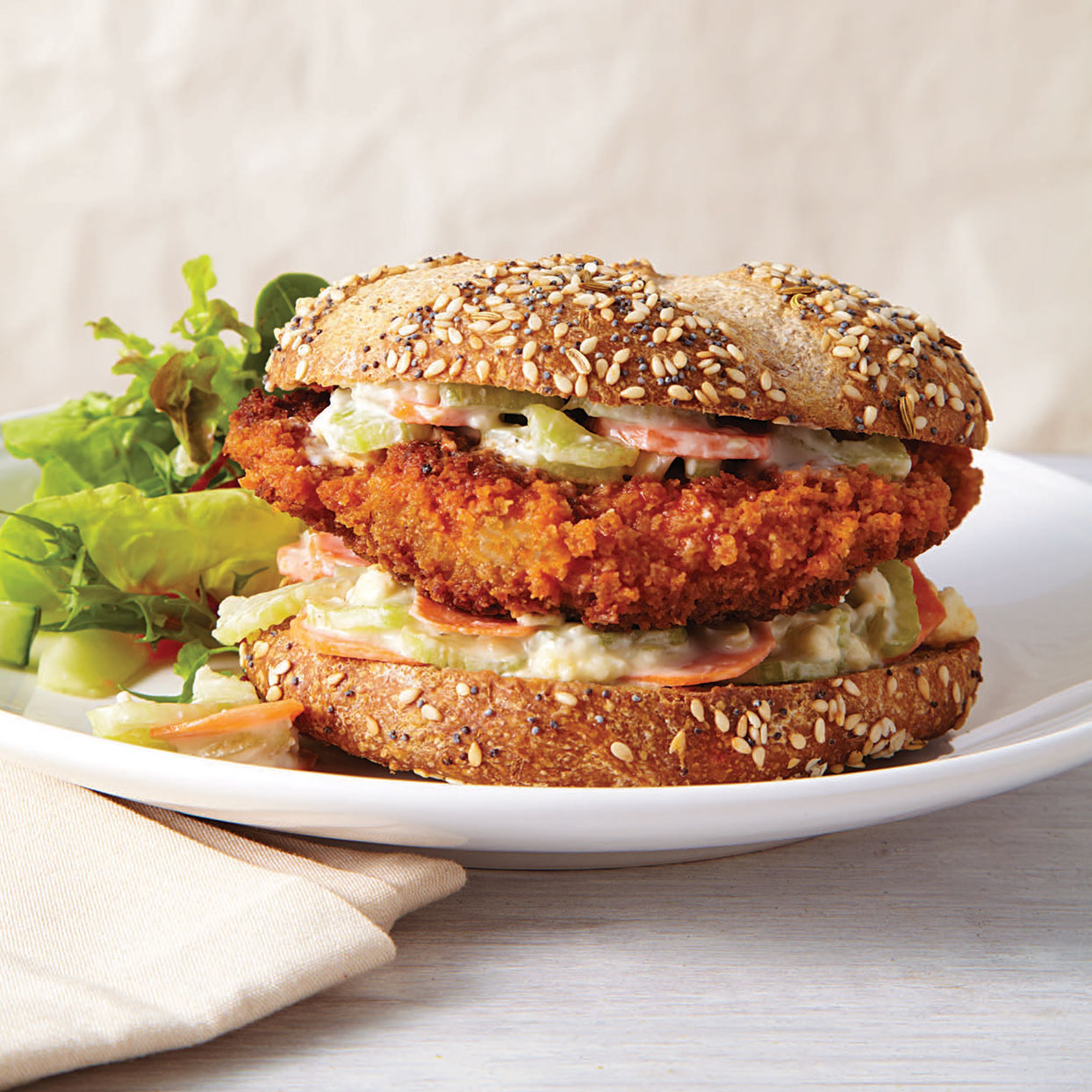 This healthy Buffalo chicken sandwich recipe takes the traditional accompaniments to Buffalo chicken wings--carrots, celery and blue cheese dip--and turns them into a crunchy slaw to top the sandwich Source: EatingWell Magazine, November/December 2013